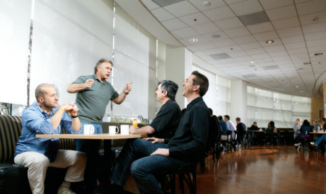Jobs' inner circle includes (from left) Jonathan Ive, Phil Schiller, Eddy Cue, and Scott Forstall, photographed on the Apple Campus in 2010.