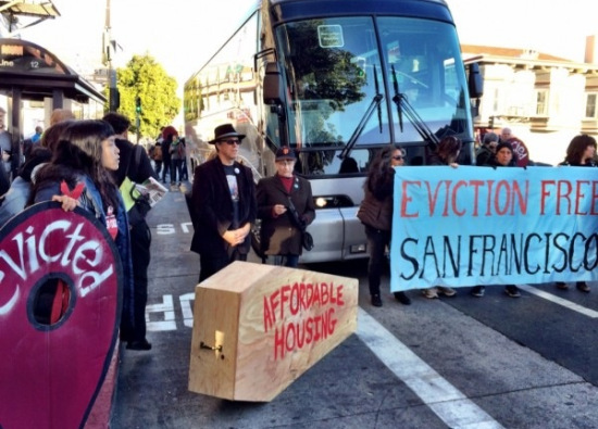 Protestors surrounded an Apple bus Friday in San Francisco.