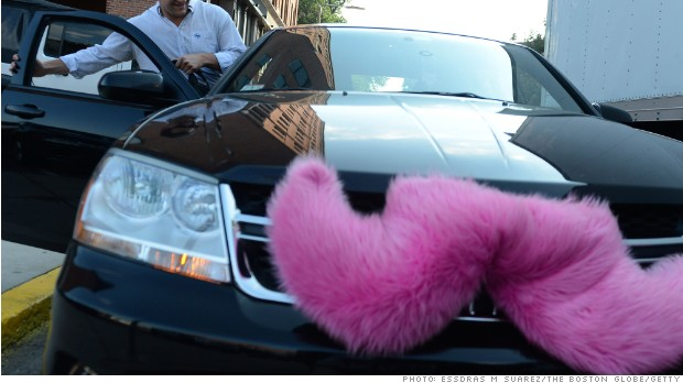 Boston, MA 071613 Hunter Perry (Cq)( a regular Lyft user gets picked up on July 16, 2013 near his office on Harrison Ave. The vehicles participating in the Lyft program wear a pink mustache on their front grille. (Essdras M Suarez/ Globe Staff)/ MET
