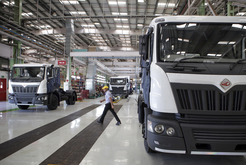Mahindra Navistar trucks on an assembly line in Maharashtra, India.