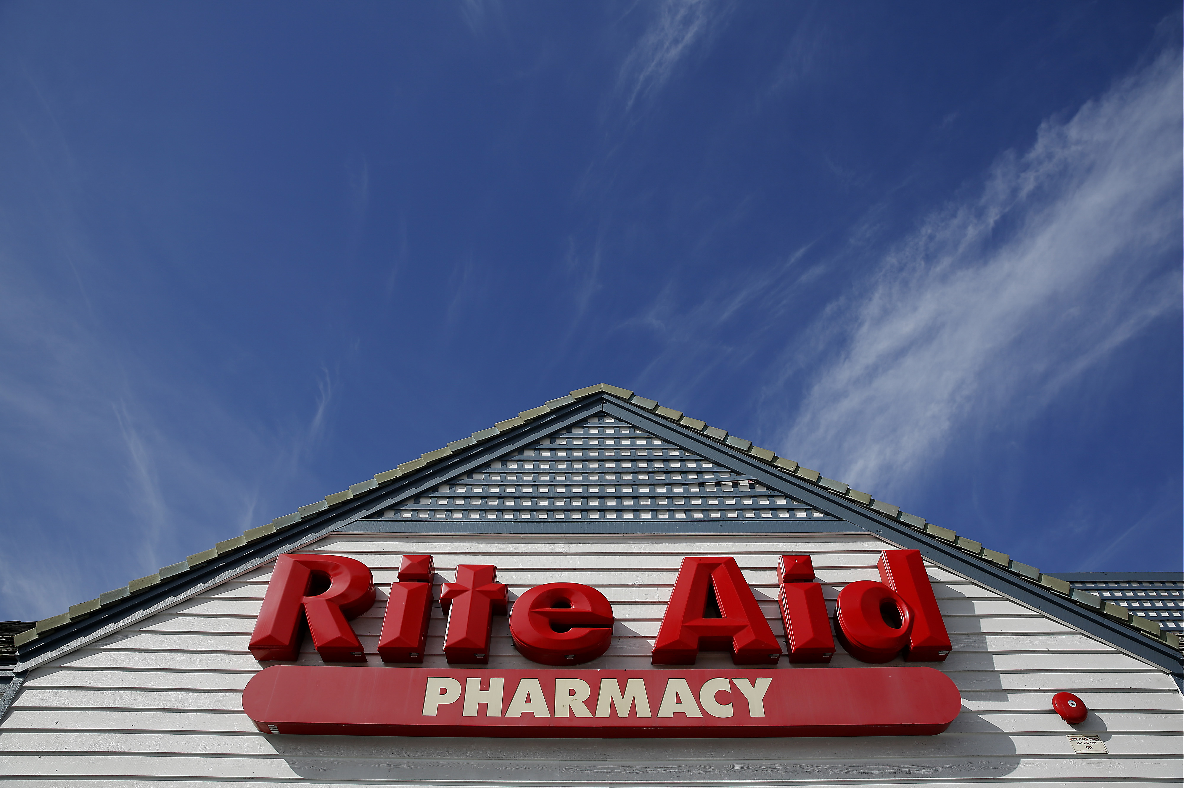 Signage is displayed outside of a Rite Aid Corp. store in Redondo Beach, California, U.S.