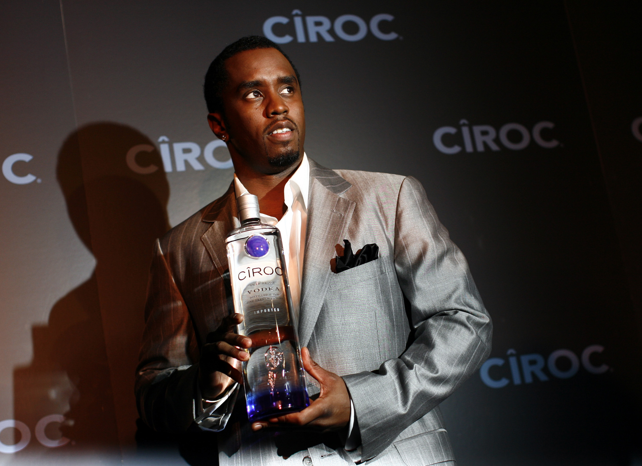 "Sean ""Diddy"" Combs poses with a bottle of Ciroc vodka before a press conference announcing his alliance with the Diageo spirits company in New York"