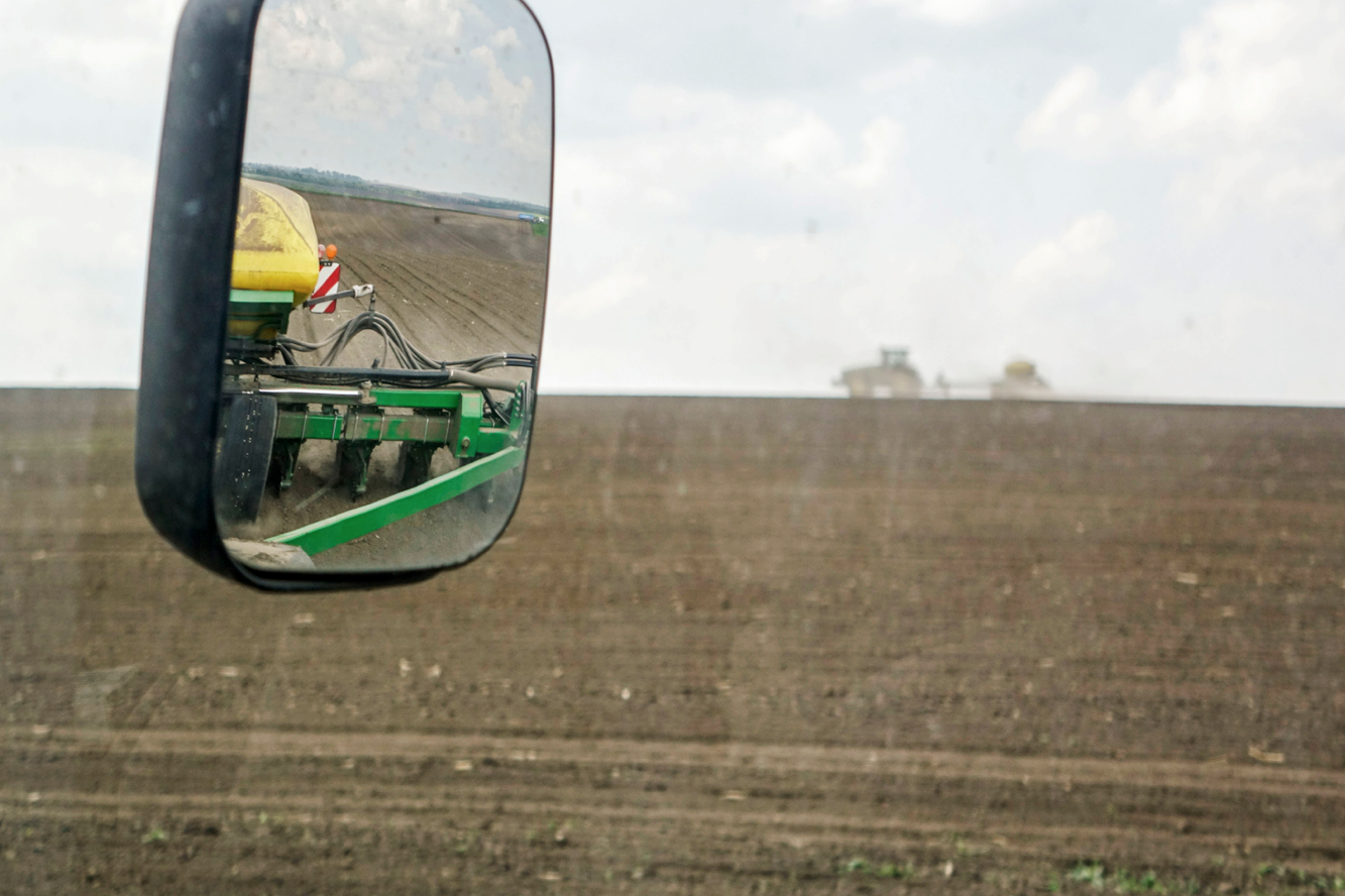 A farmer sows a field of corn seeds in the countryside outside Ternopil, Ukraine, on Friday, May 2, 2014.
