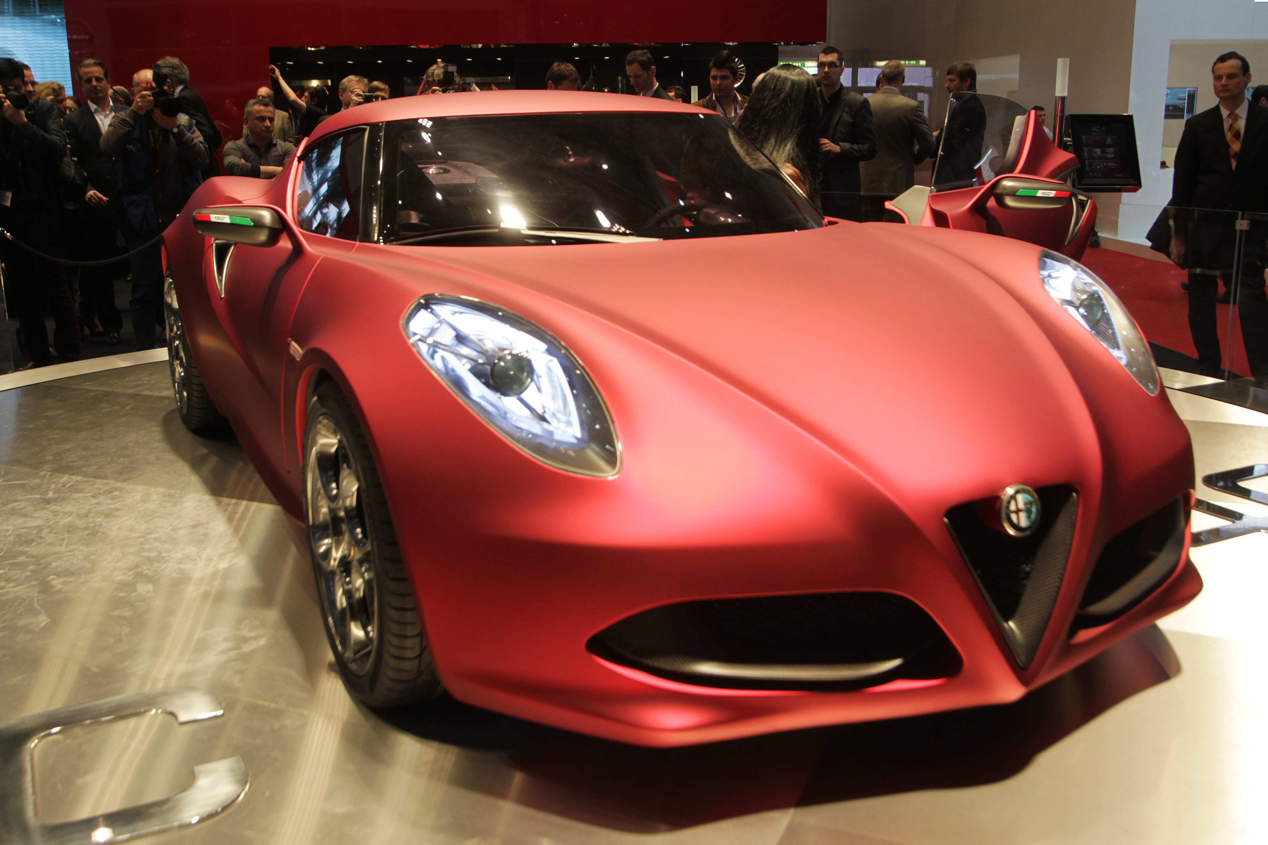 An Alfa Romeo 4C is displayed at the car