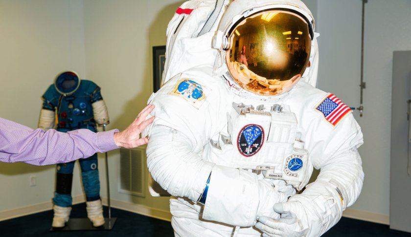 At ILC Dover, which made the first space suits for walking on the Moon, a lab manager tests new components on a suit used aboard the International Space Station.