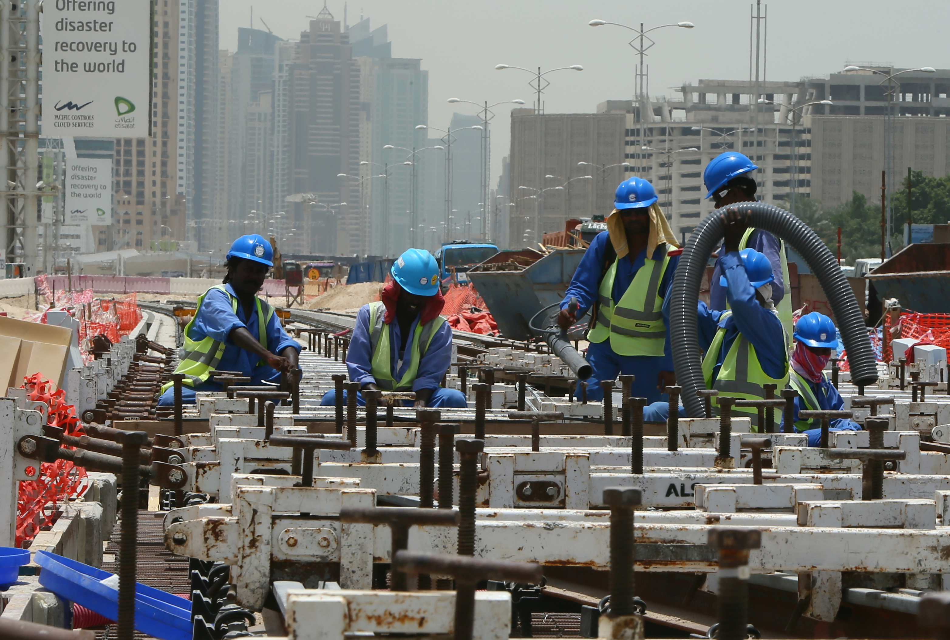 Asian immigrant workers building Dubai's new  subway for Arabtec.