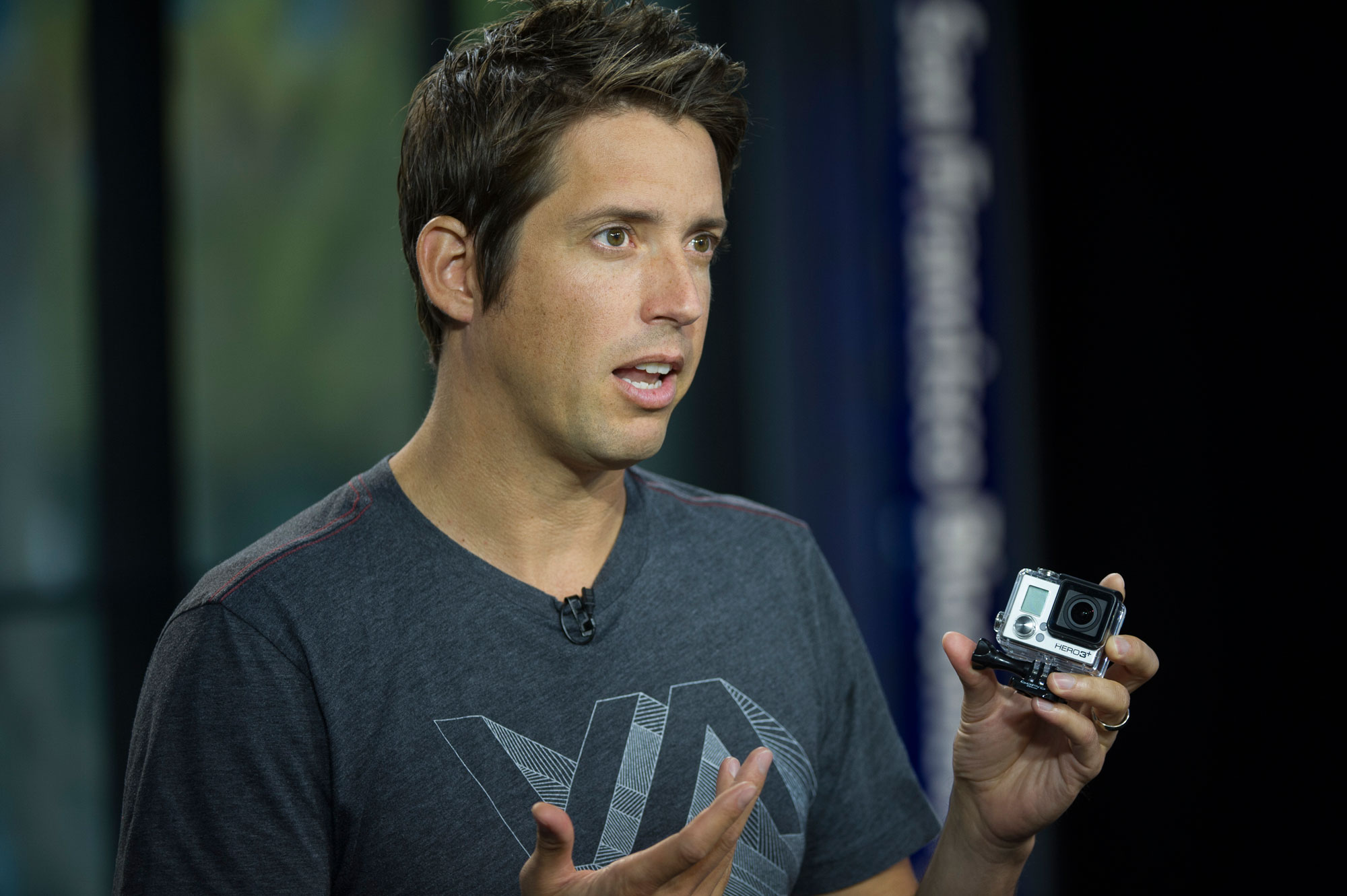 "Nicholas ""Nick"" Woodman, founder and chief executive officer of GoPro, holds a GoPro Hero 3+ camera."