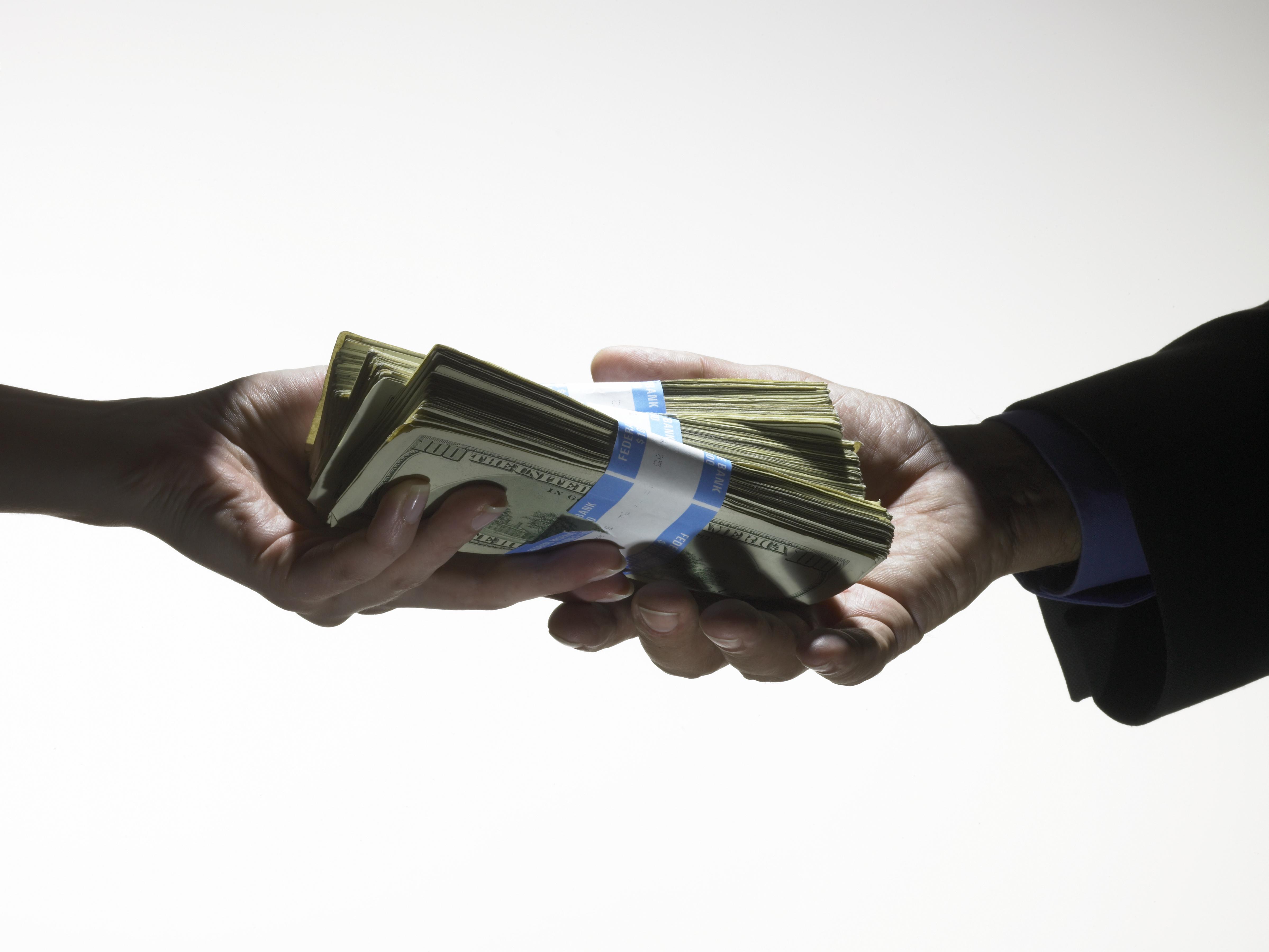 money exchanging hands payment