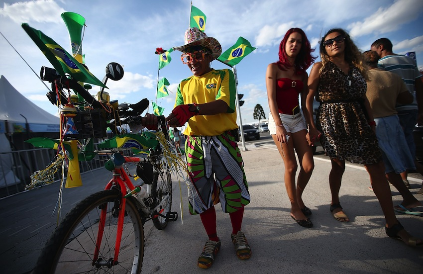 A Brazil fans stands outside of opening ceremony rehearsals around Itaquerao stadium