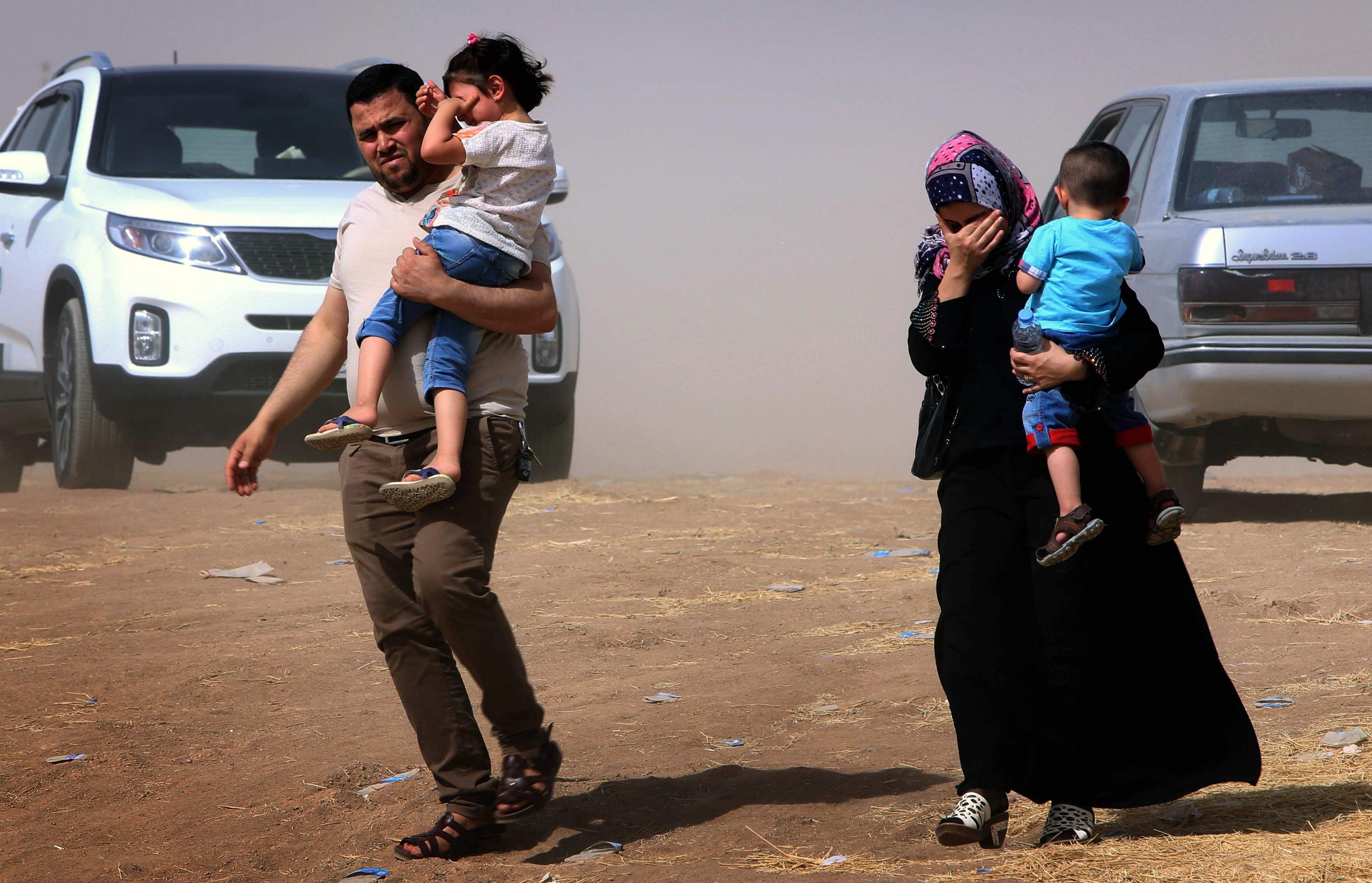An Iraqi family fleeing violence in the northern Nineveh province arrives at a Kurdish checkpoint autonomous Kurdistan region.