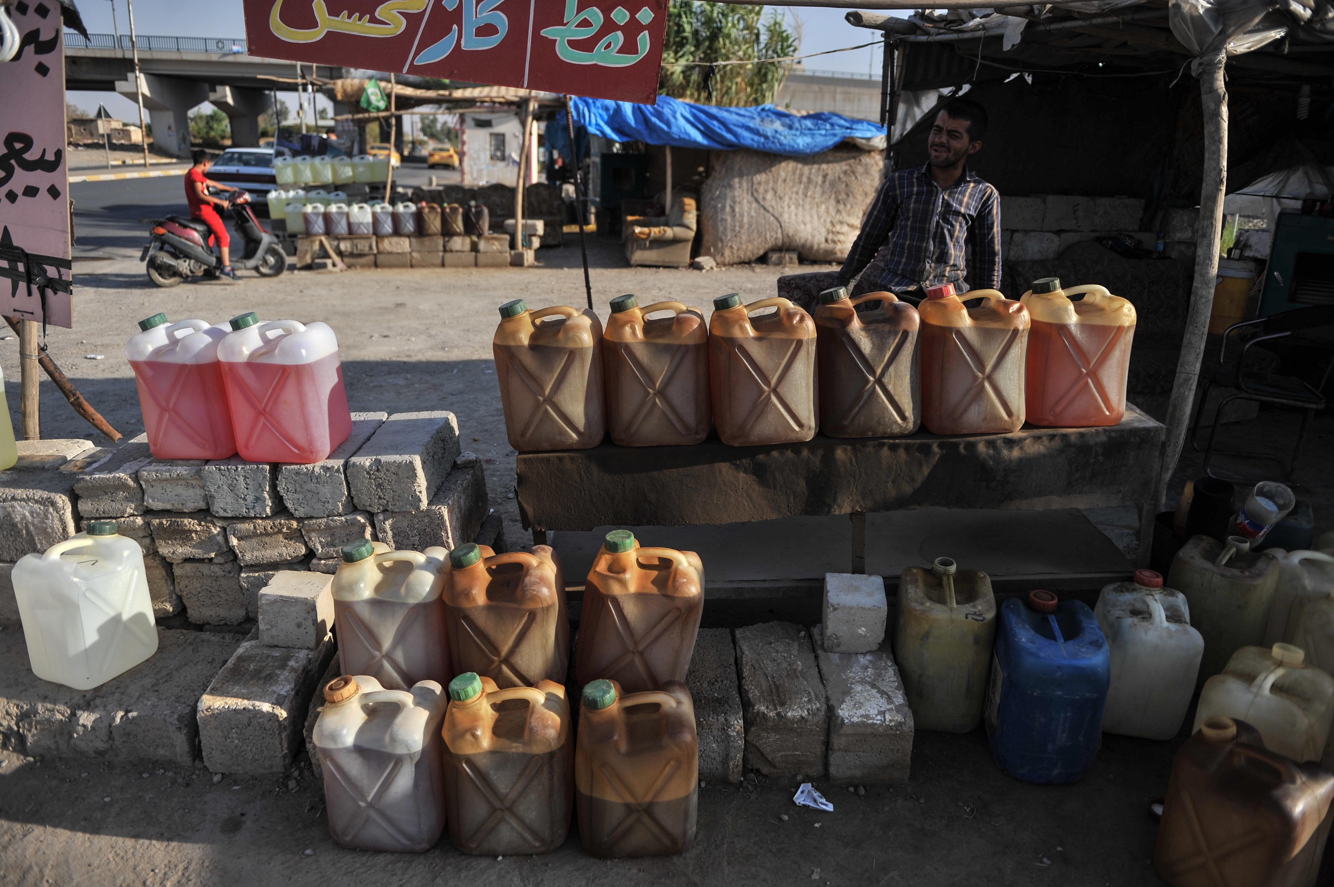 Gasoline filled in to plastic bottles on display at a roadside shop in the  Kirkuk, Iraq.