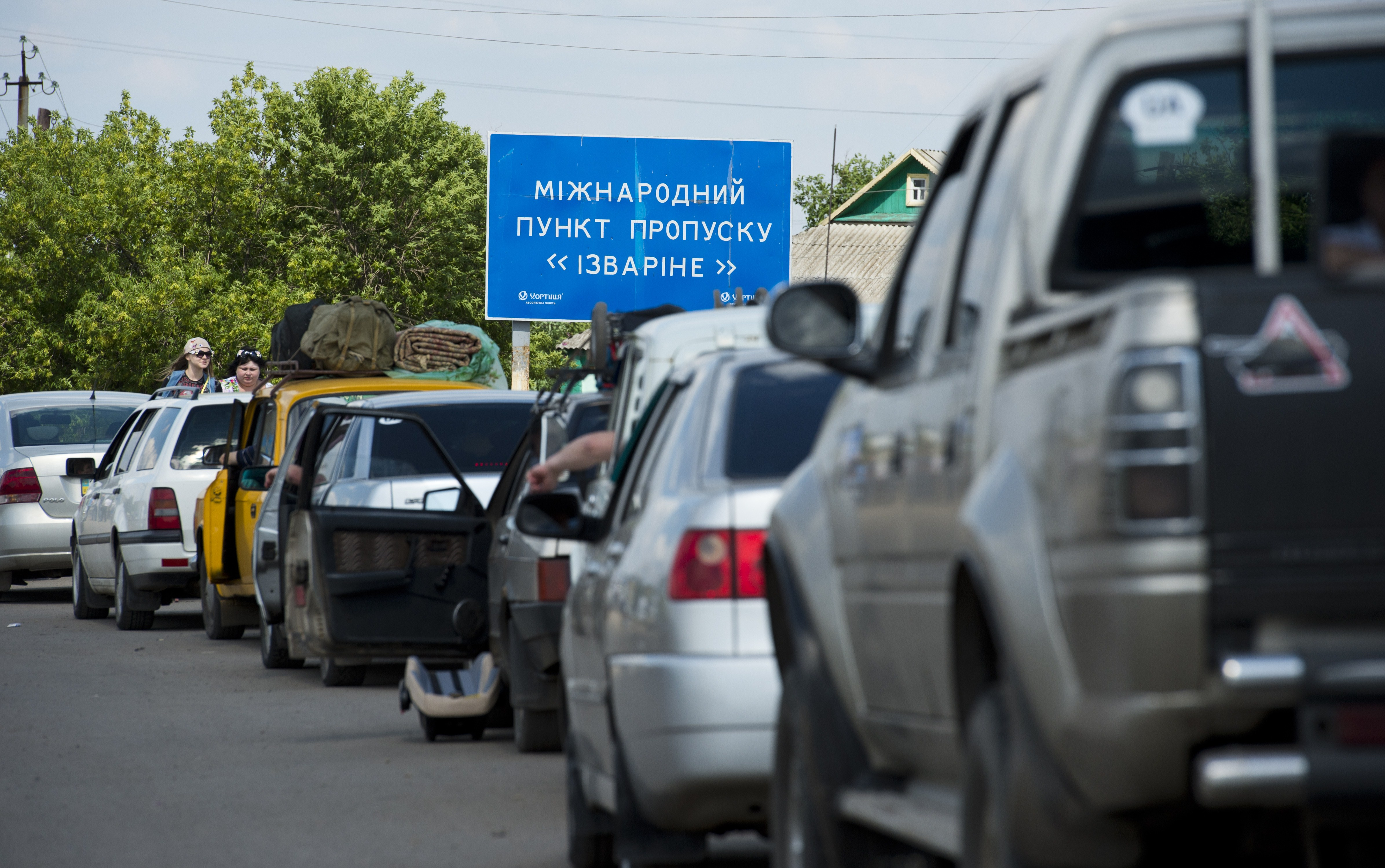 They'll believe it when they see it. Refugees fleeing the conflict zones in eastern Ukraine wait to cross the border into Russia.