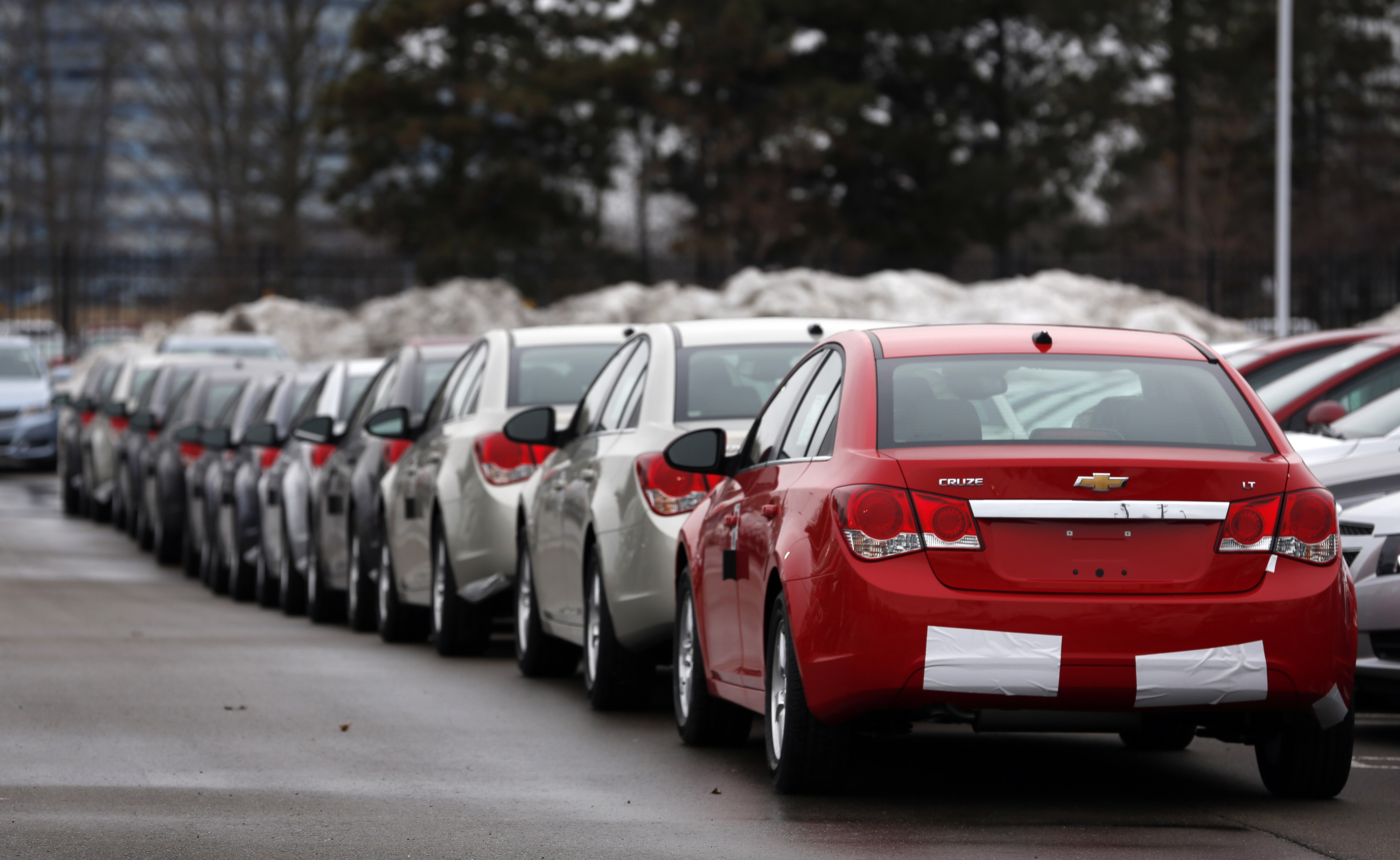 General Motors Chevrolet Cruze vehicles sit on the lot at a dealership in Southfield, Mich.
