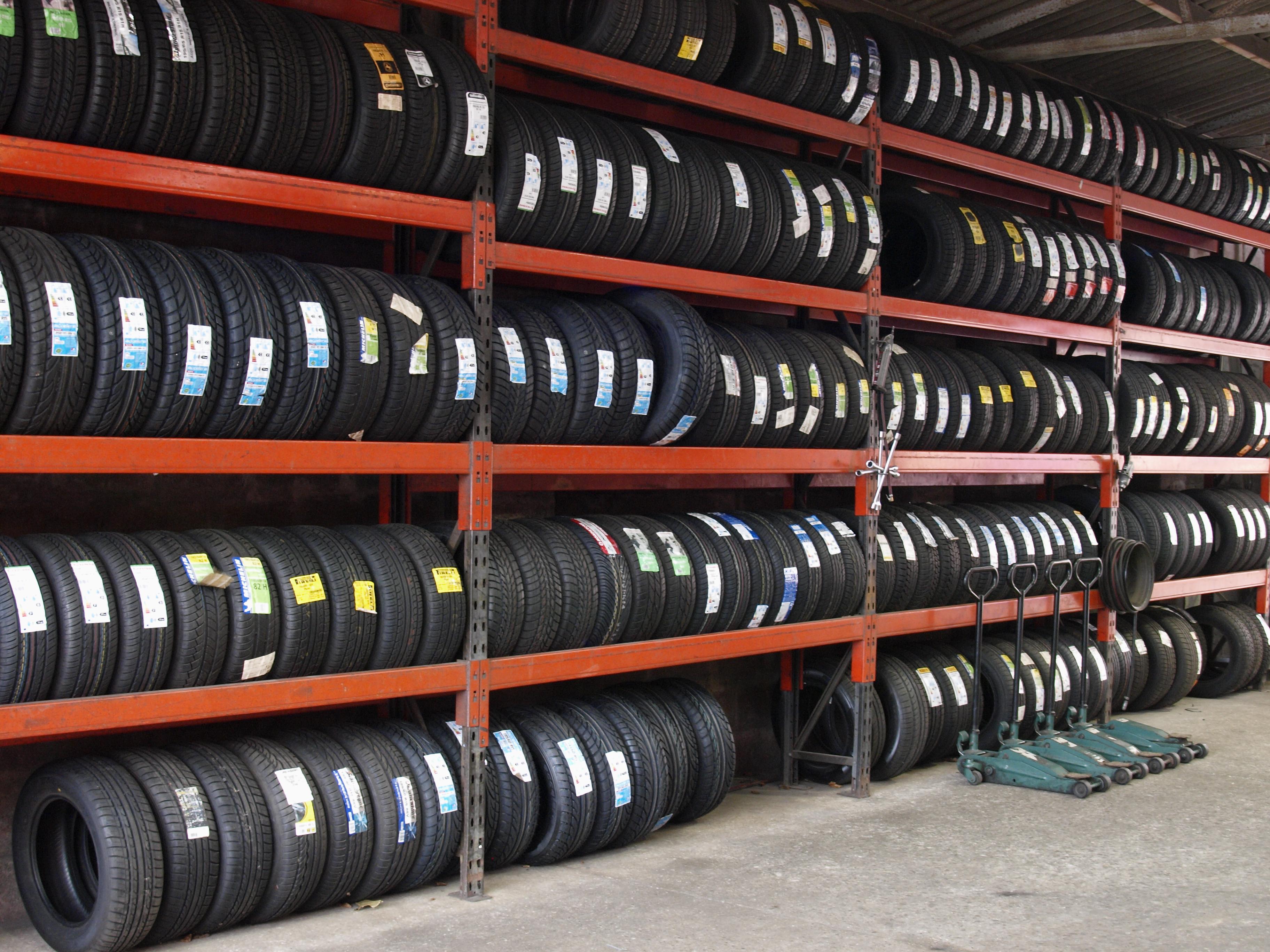 Rows of new tires at a repair center, Bideford, Devon