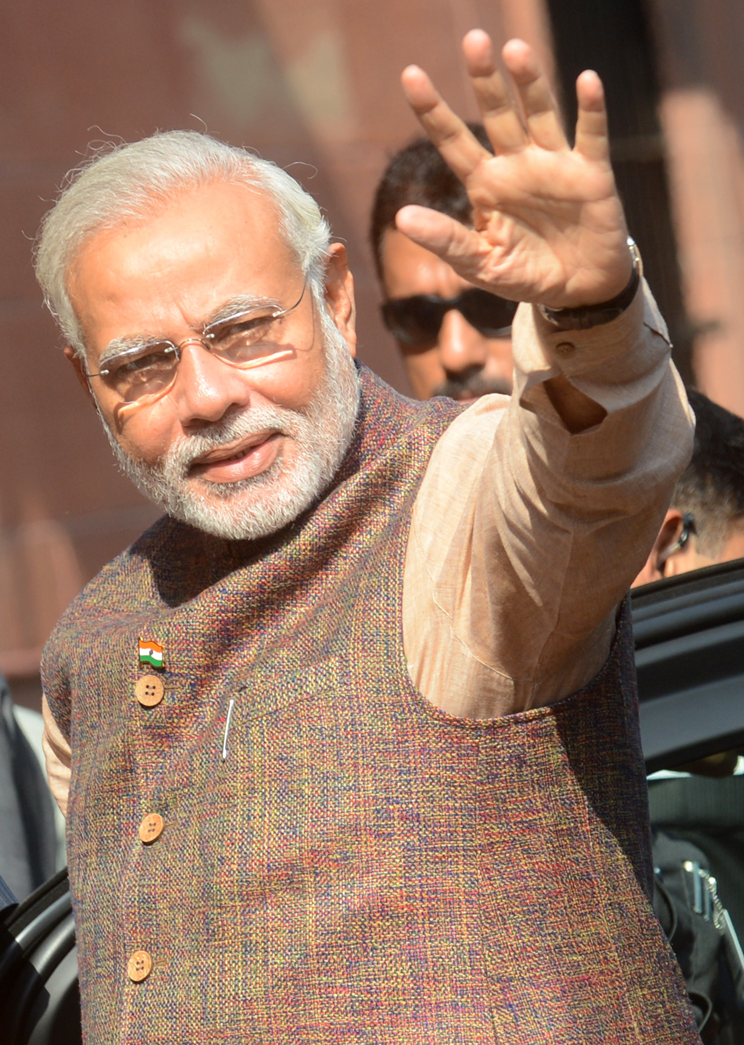 Prime Minister Narendra Modi (C) gestures during his arrival at the Prime Minister's Office at South Block in New Delhi on May 27, 2014.