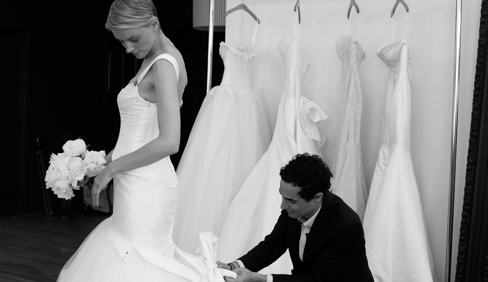 Zac Posen works on a wedding gown that is sold at David's Bridal.