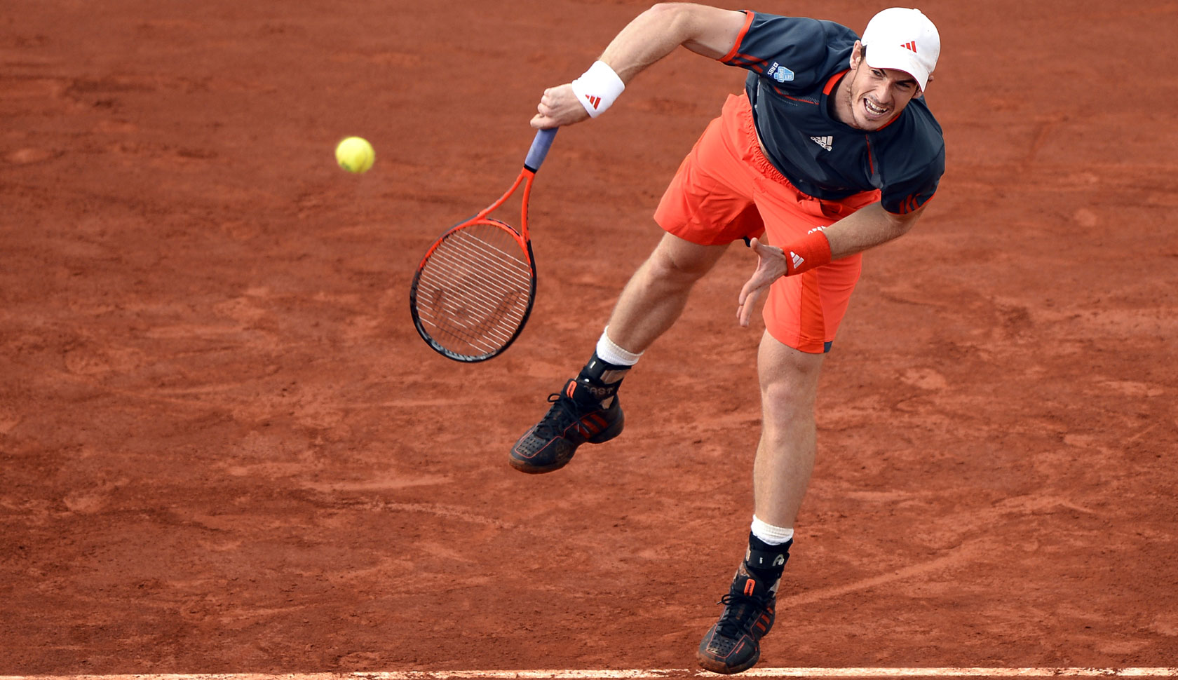 Britain's Andy Murray serves to Spain's