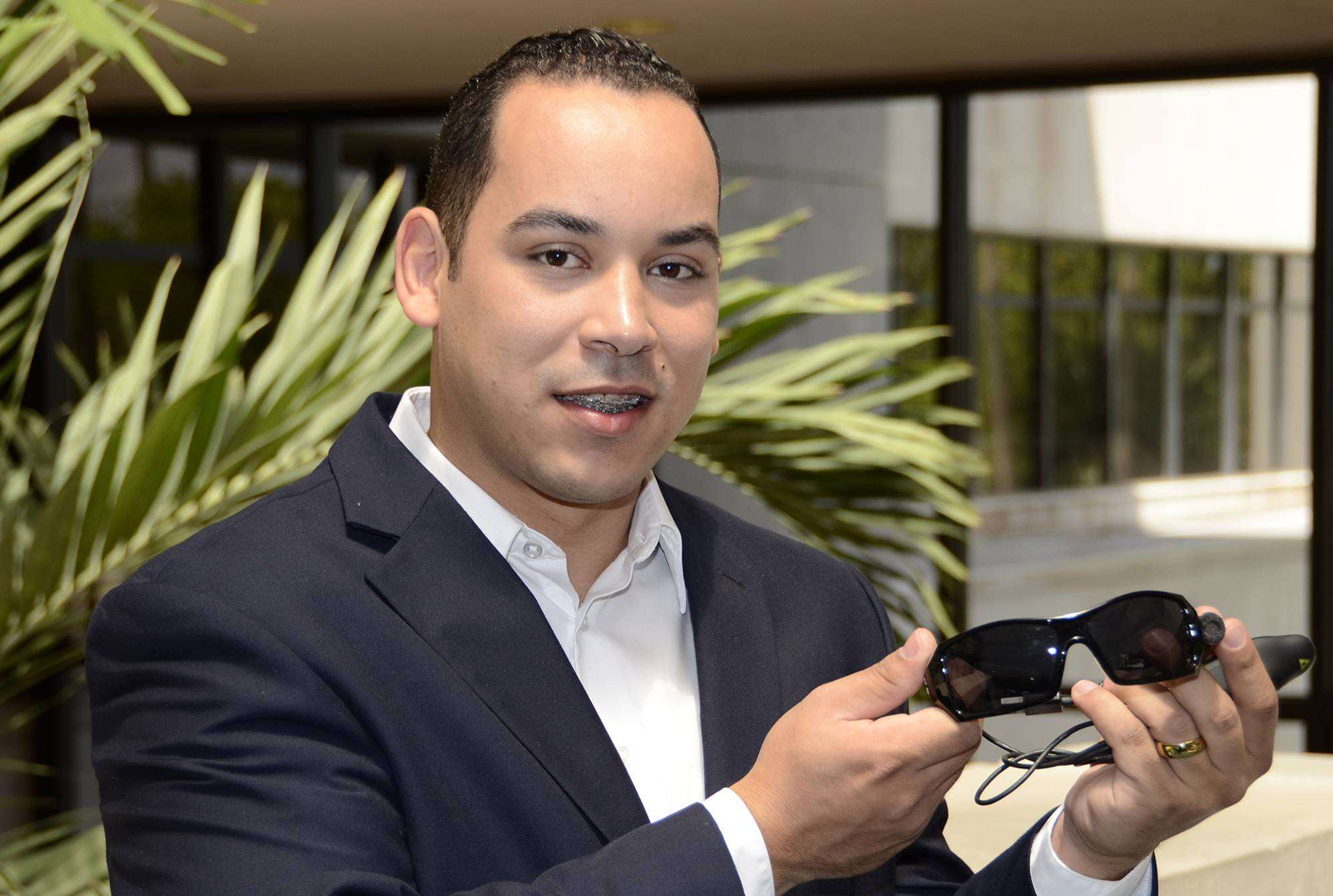 Viurniel Sanchez holds his device which reads to the blind in Miami, Fla. on May 19, 2014. Photo by Doug Murray/FPL