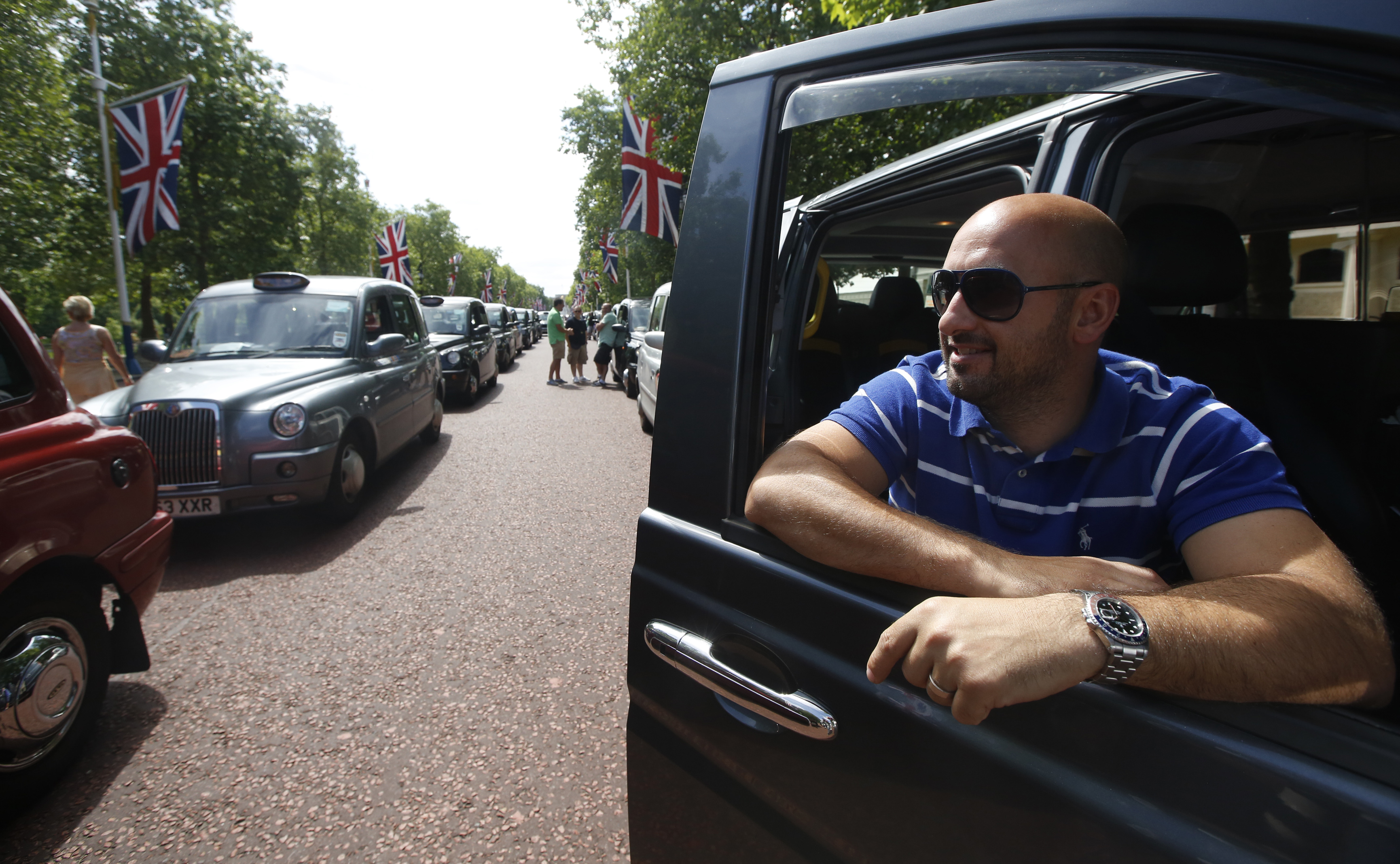 Taxi driver Joe Senatore joins other drivers during a demonstration along the Mall in central London