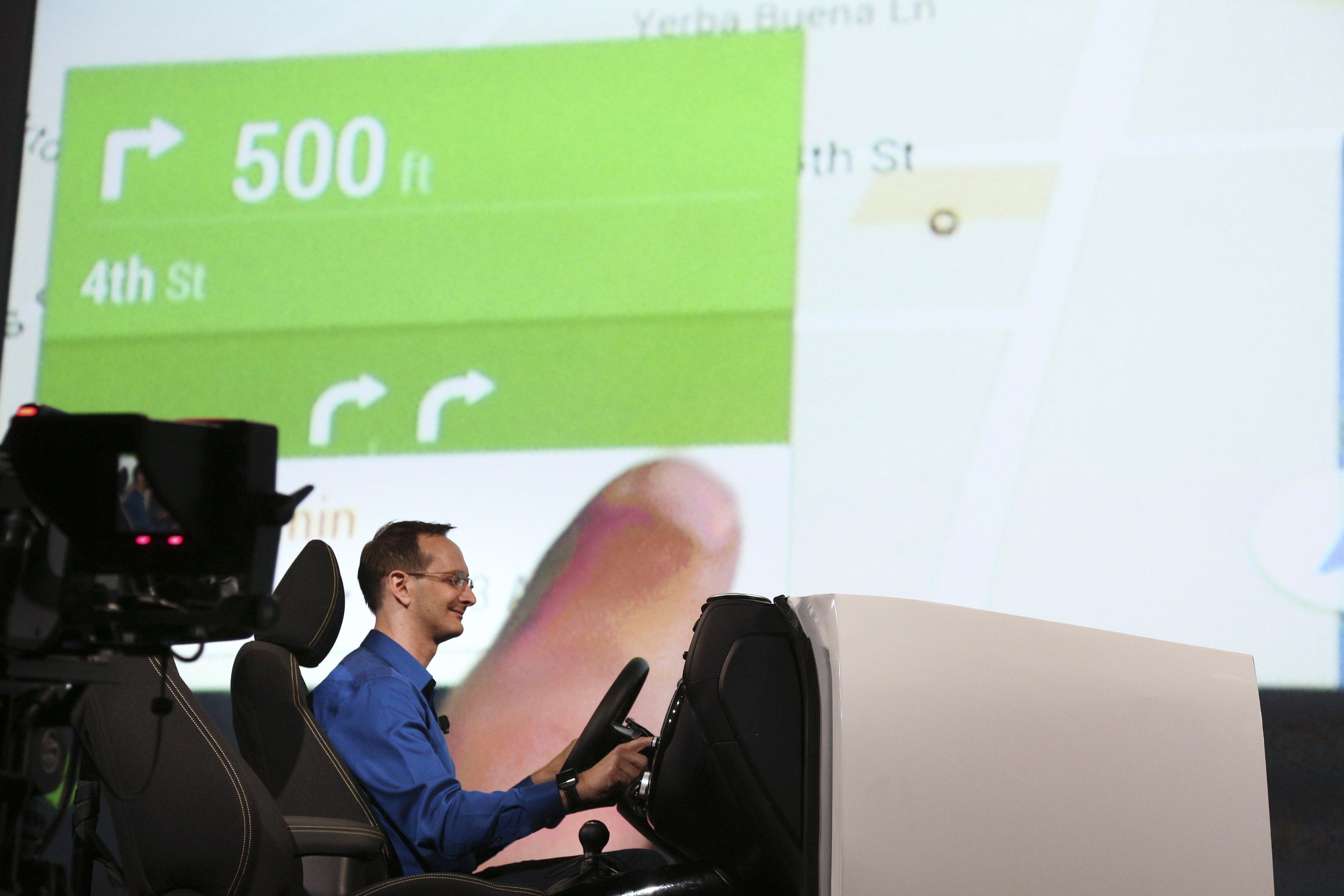 A Google employee demonstrates Android Auto onstage at the Google I/O developers conference in San Francisco