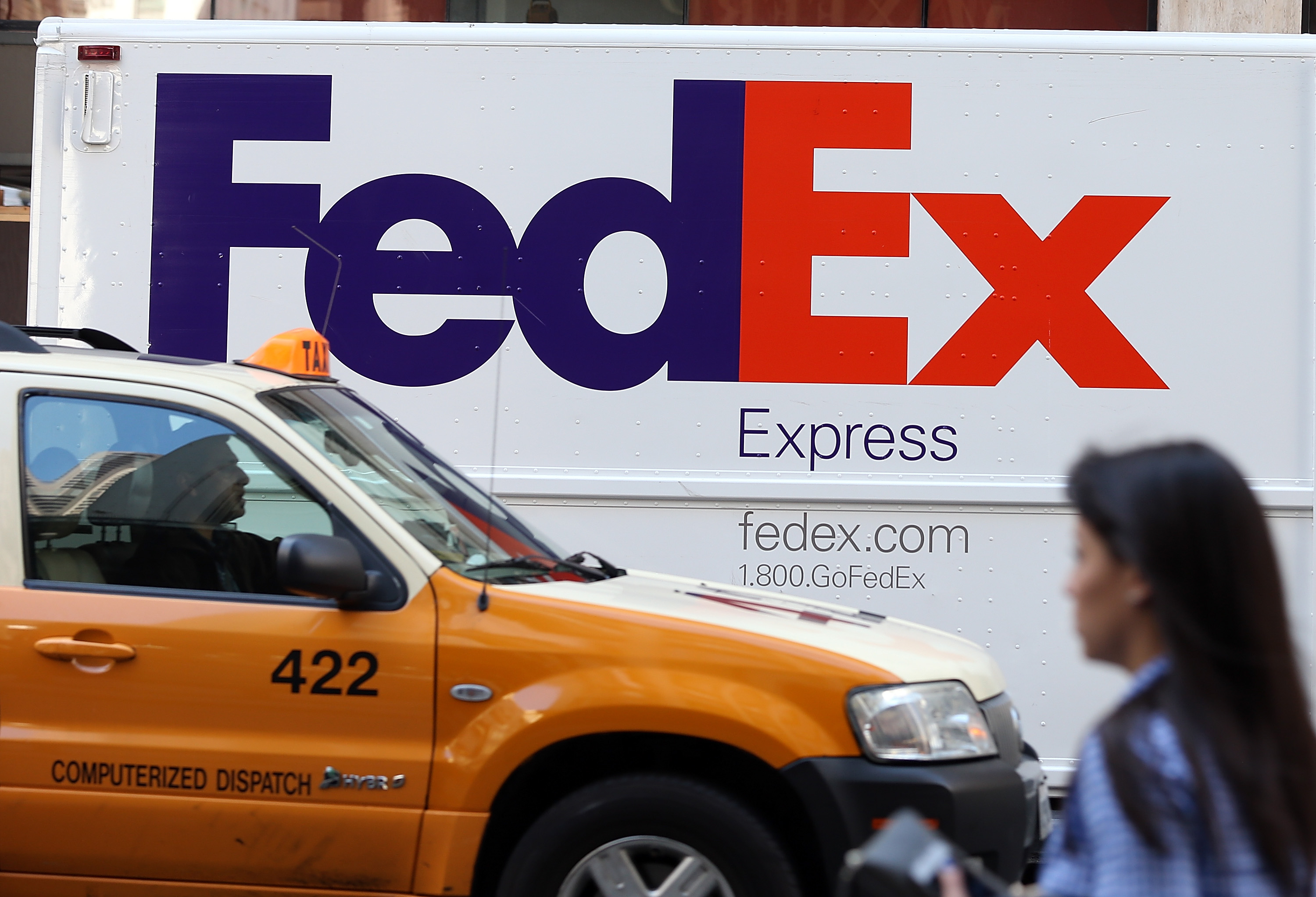 Fed Ex Drops Earnings Estimate After Profits Fall One Percent In First Quarter