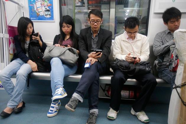Chinese commuters. Wu Hanren/AP Photo