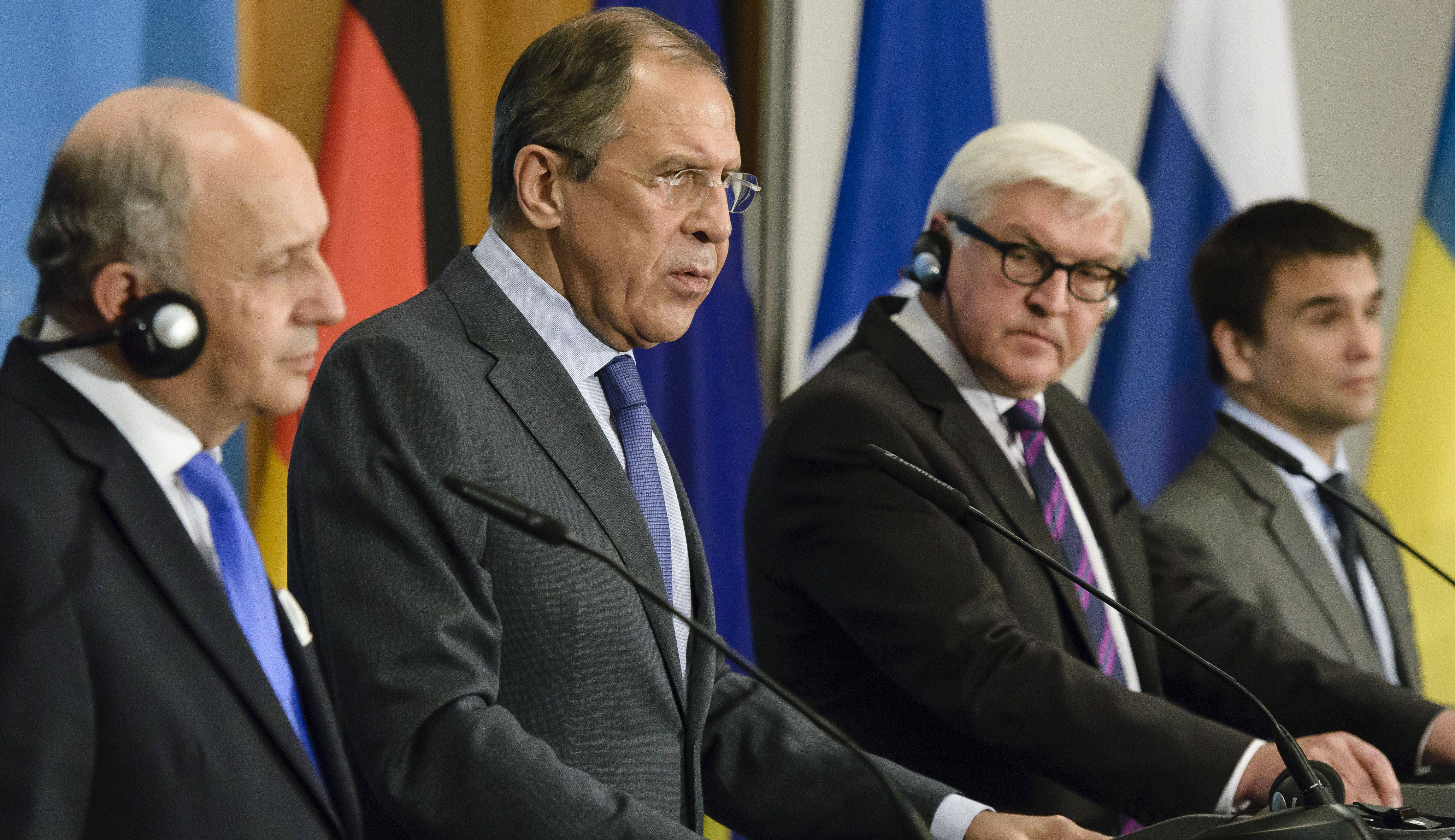 (L to R) French Foreign Minister Laurent Fabius, Russian Foreign Minister Sergei Lavrov, German Foreign Minister Frank-Walter Steinmeier and Ukrainian Foreign Minister Pavlo Klimkin address a joint press conference after talks at in Berlin.
