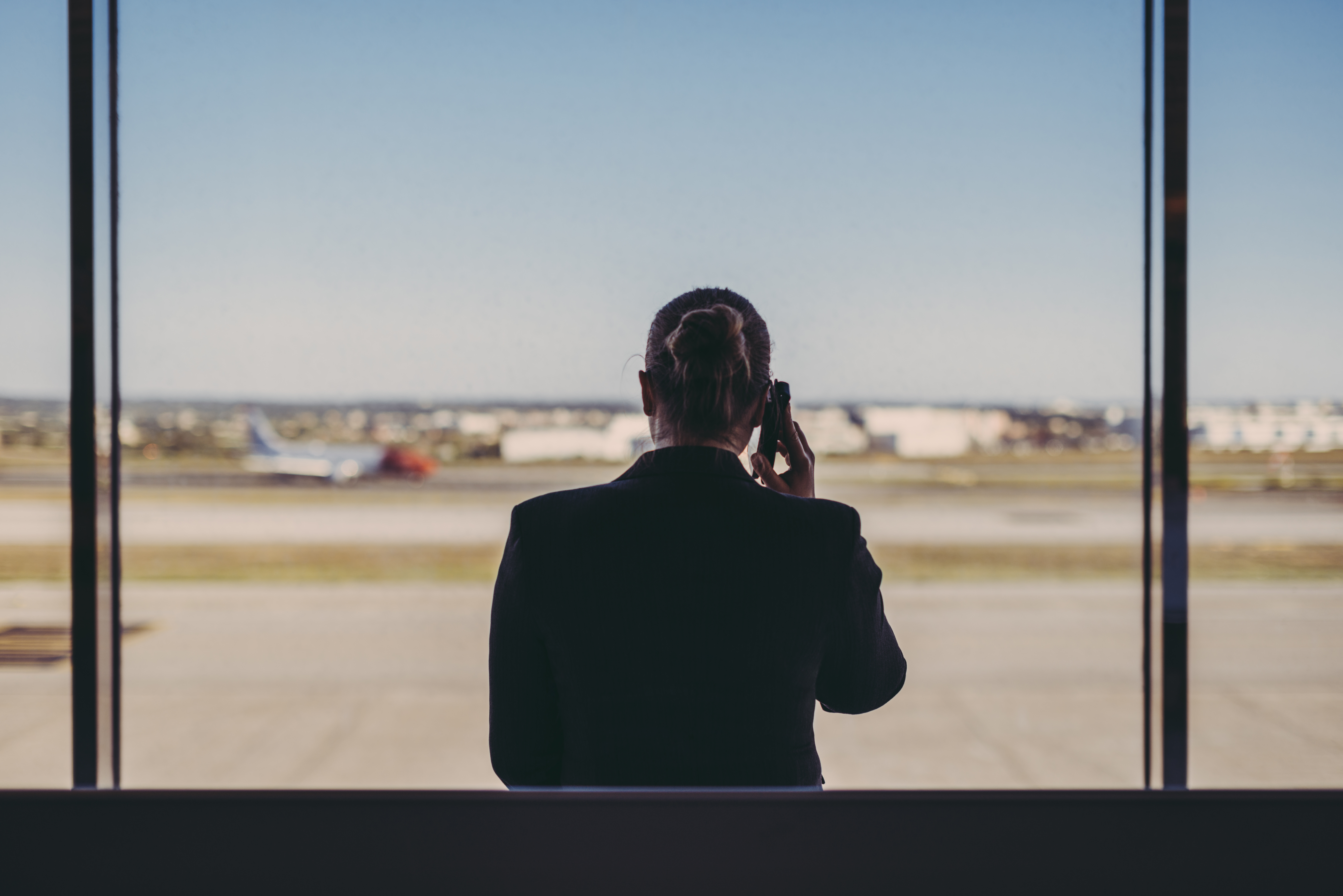 Business woman on phone at airport.