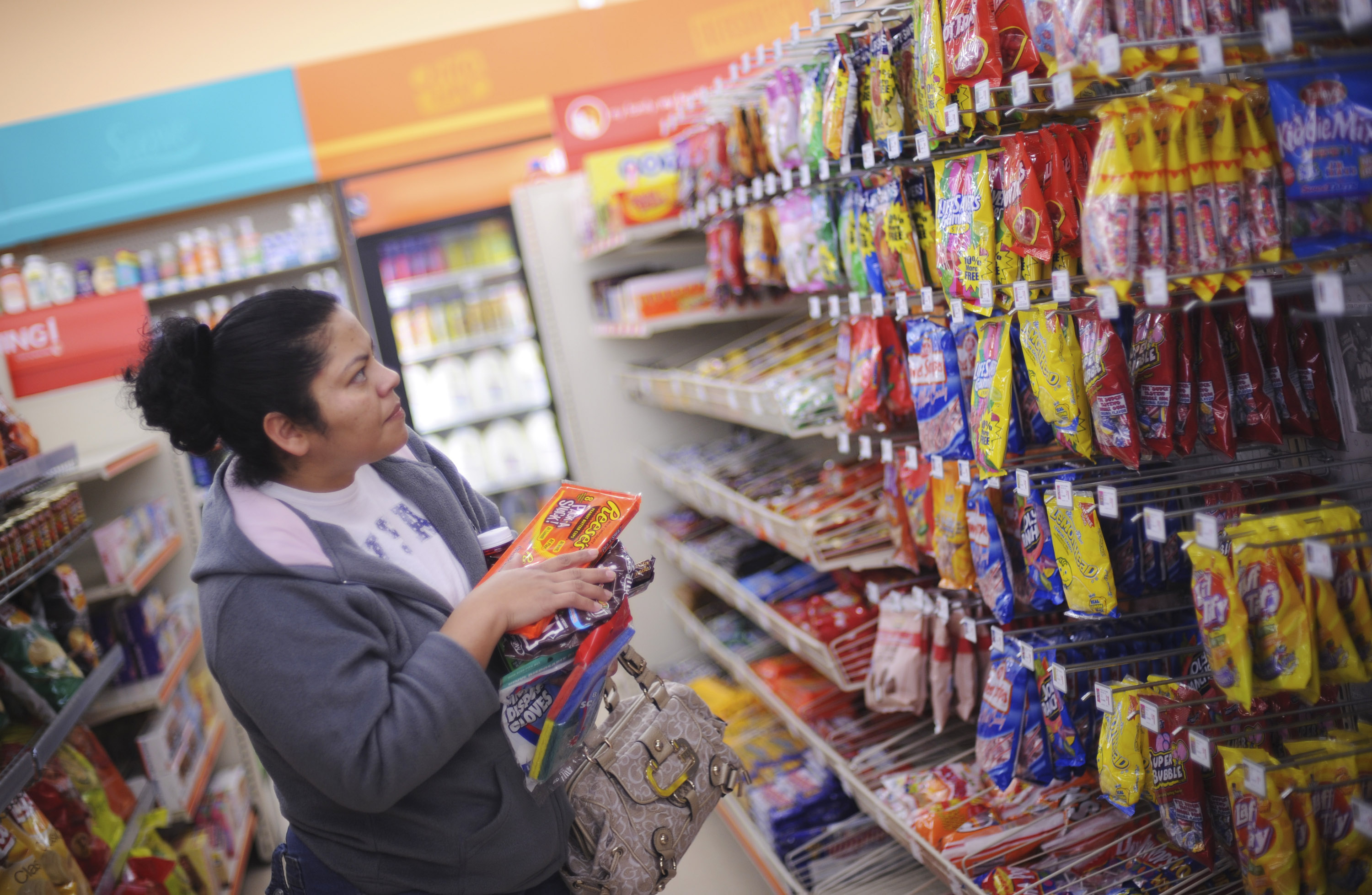 Ana Meija shops for candy at a Family Dollar store in Norcro