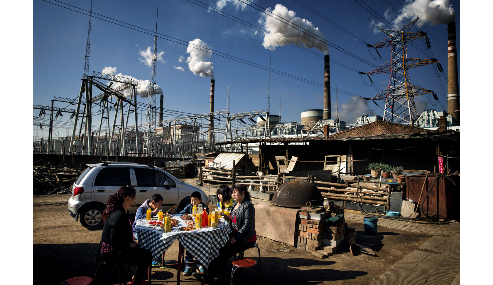 family eating near Datong No. 2 coal-fired power plant