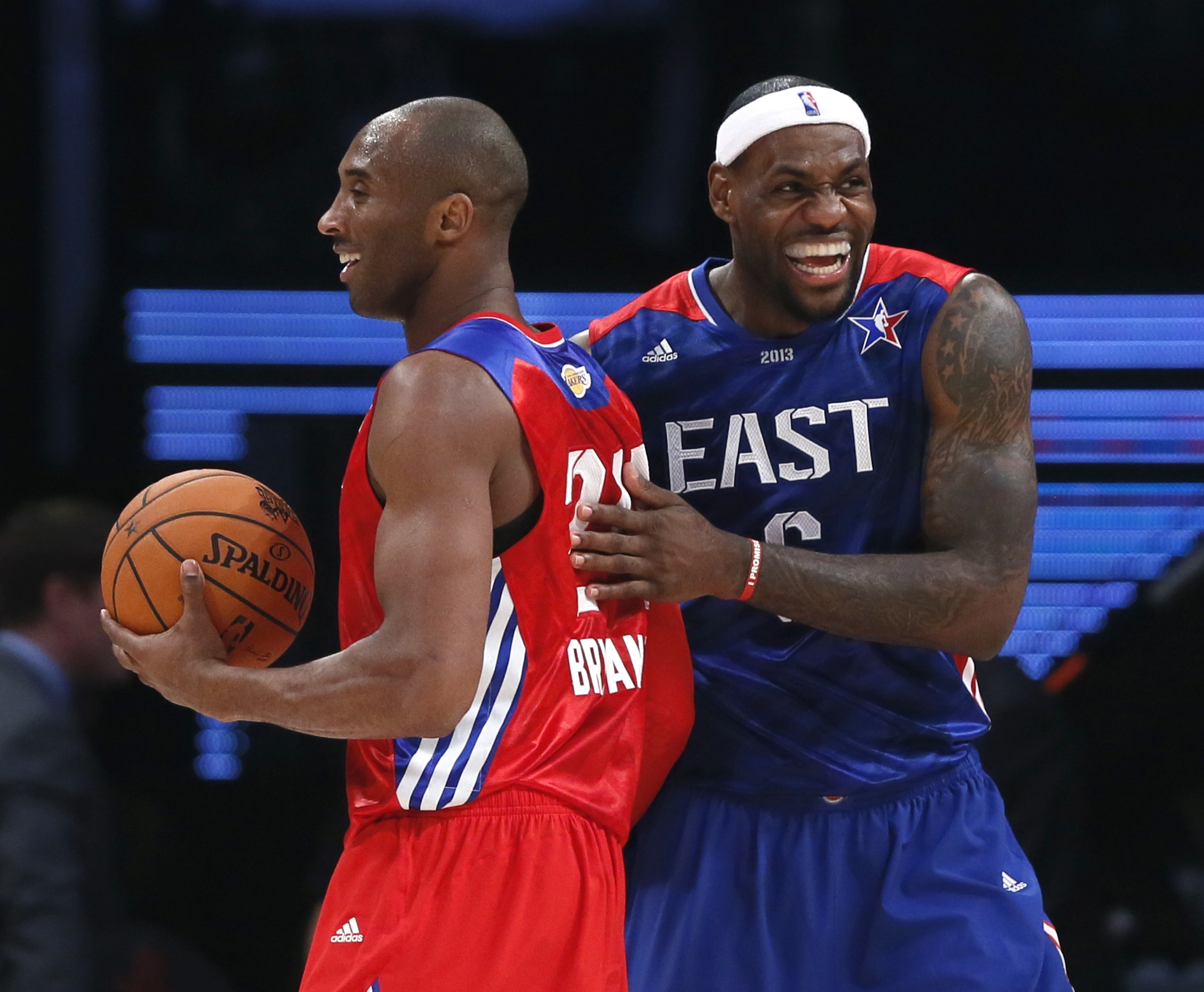 NBA All-Star Bryant of the Lakers and All-Star James of the Heat share a laugh during the NBA All-Star basketball game in Houston