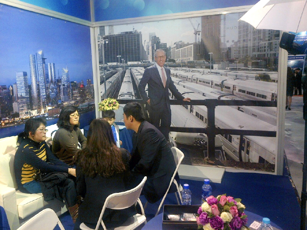 Related's booth at the Invest in America Summit EB-5trade fair in Shanghai, China. The portrait of Stephen Ross was originally commissioned for Fortune's story on their Hudson Yards  project.