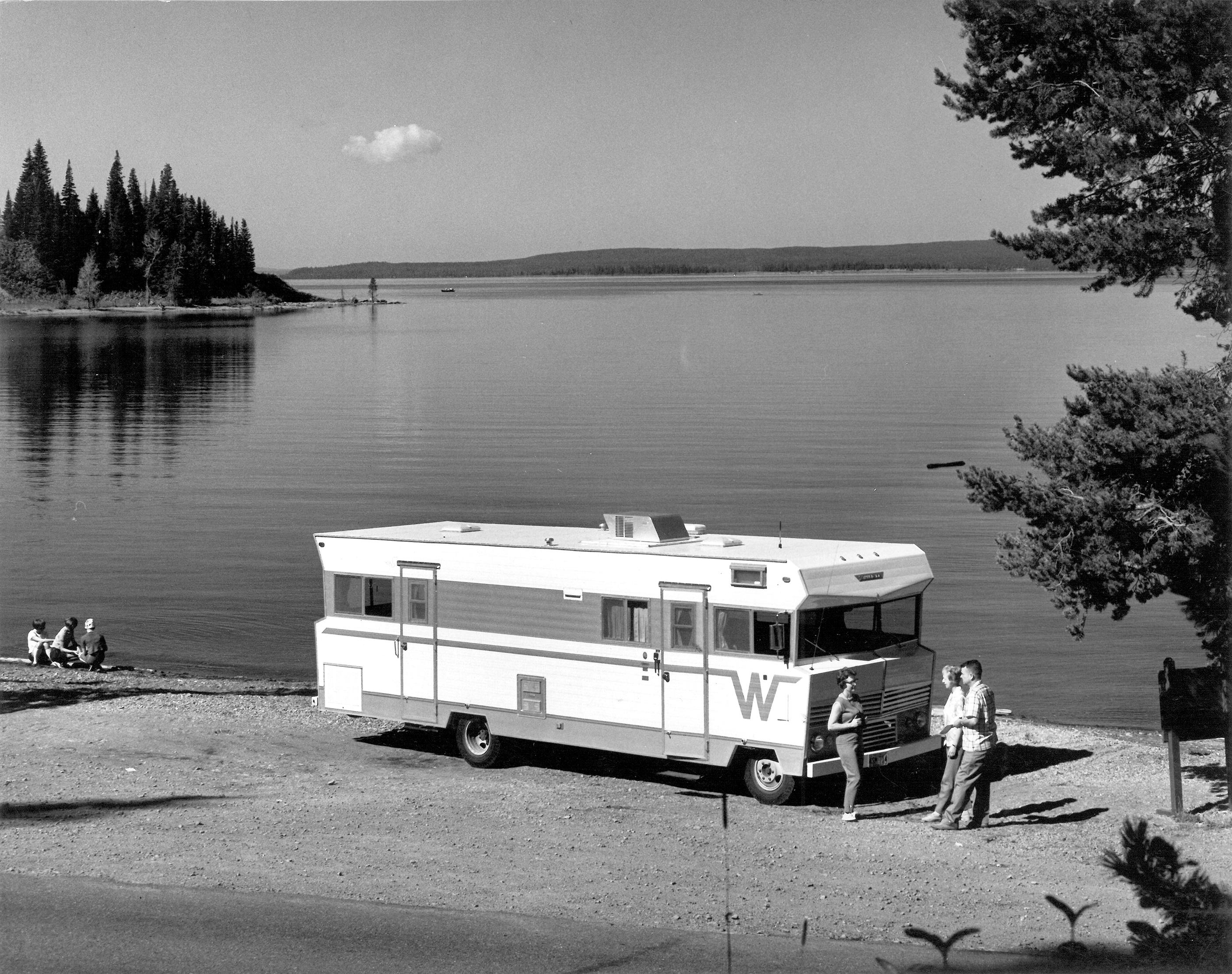 "Winnebago started producing motor homes in 1966. With the flying W logo and the over-the-cabin ""eyebrow"", this one, a 1968 D-27 (a 27-footer), has the classic features, plus a ""private entrance"" to the rear twin bedroom, his and her wardrobes and wall-to-wall carpeting."