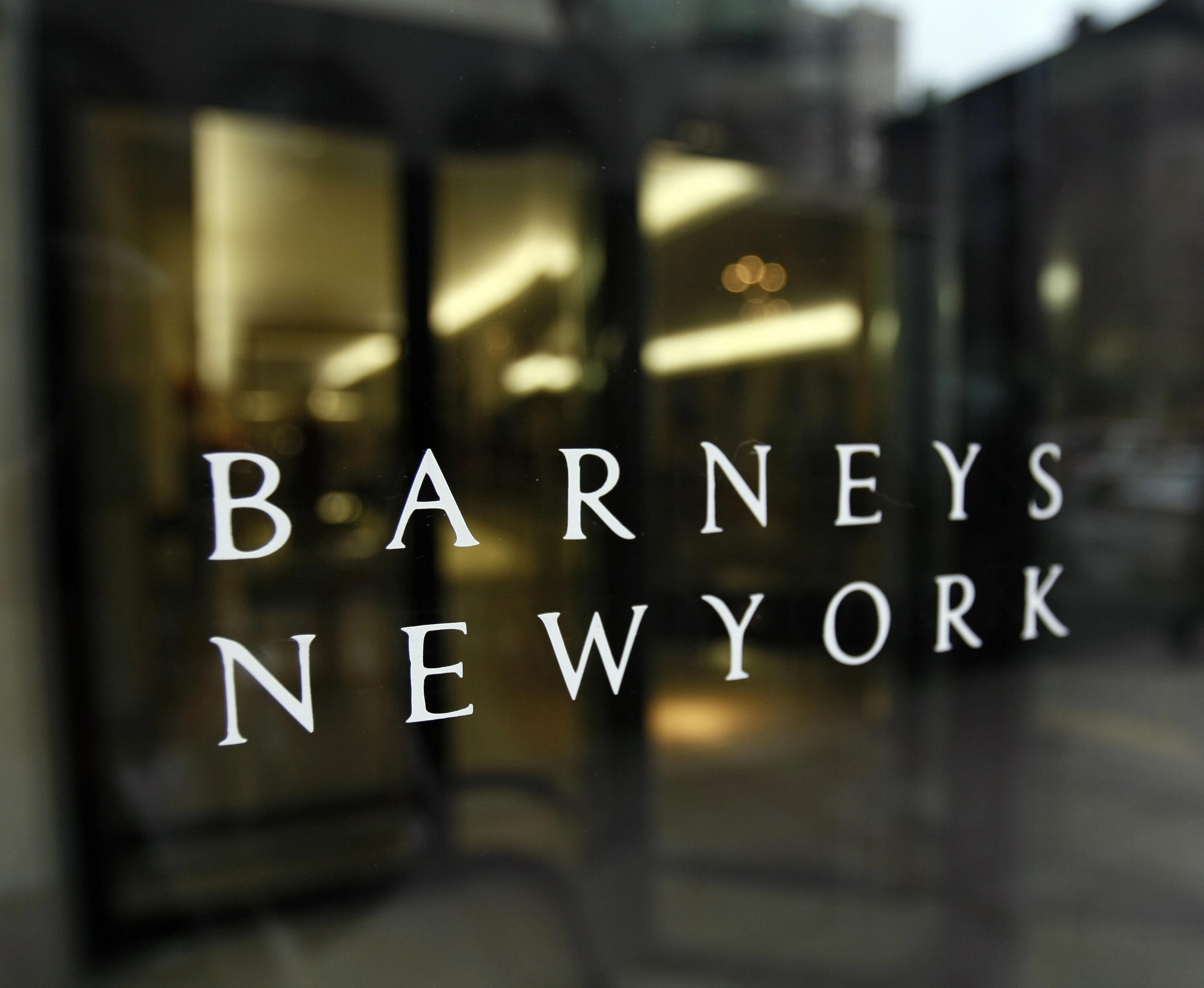 (FILES) The front window of Barneys New