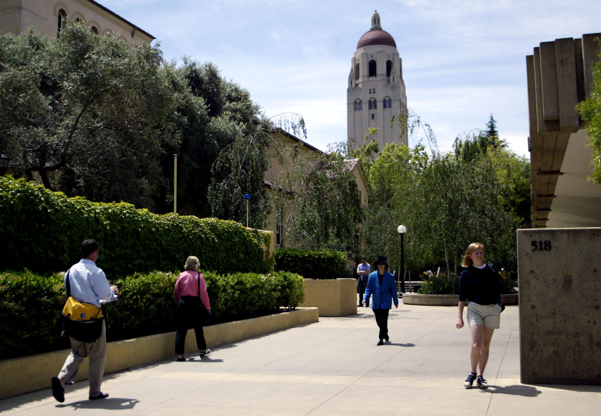 Students walk past Stanford University's Graduate School of