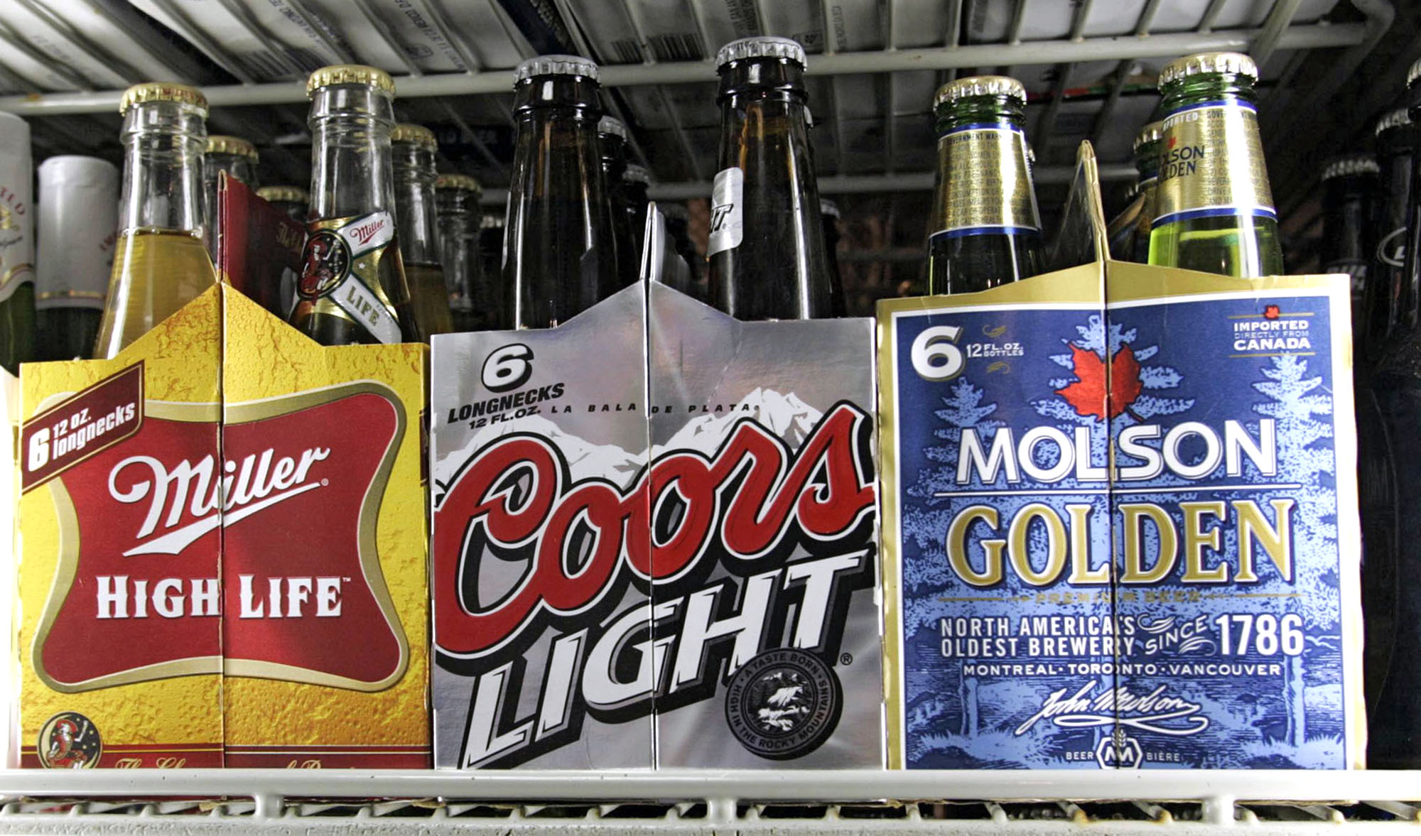 Six packs of Miller High Life, Coors Light and Molson Golden