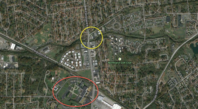 The headquarters of Emerson Electronics, at 8000 W Florissant Ave, Ferguson, MO, are circled in red. Circled in yellow is the Ferguson QuikTrip at 9420 W Florissant Ave, which was looted during the first days of the protests.