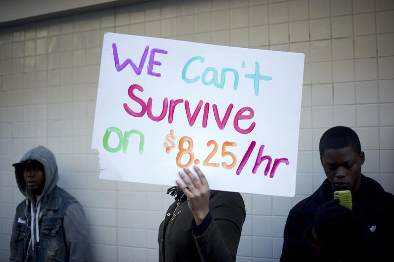 Protesters calling for higher wages for fast-food workers stand outside a McDonald's restaurant in Oakland