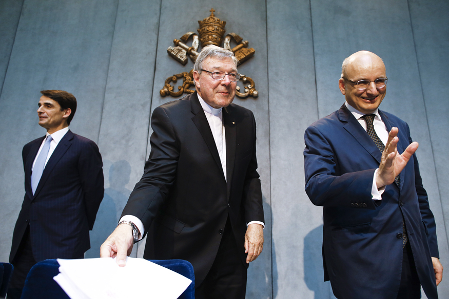 Jean-Baptise de Franssu (L), new president of Vatican Bank IOR, outgoing President Ernst Von Freyberg (R) and Cardinal George Pell at a news conference at the Vatican July 9, 2014.