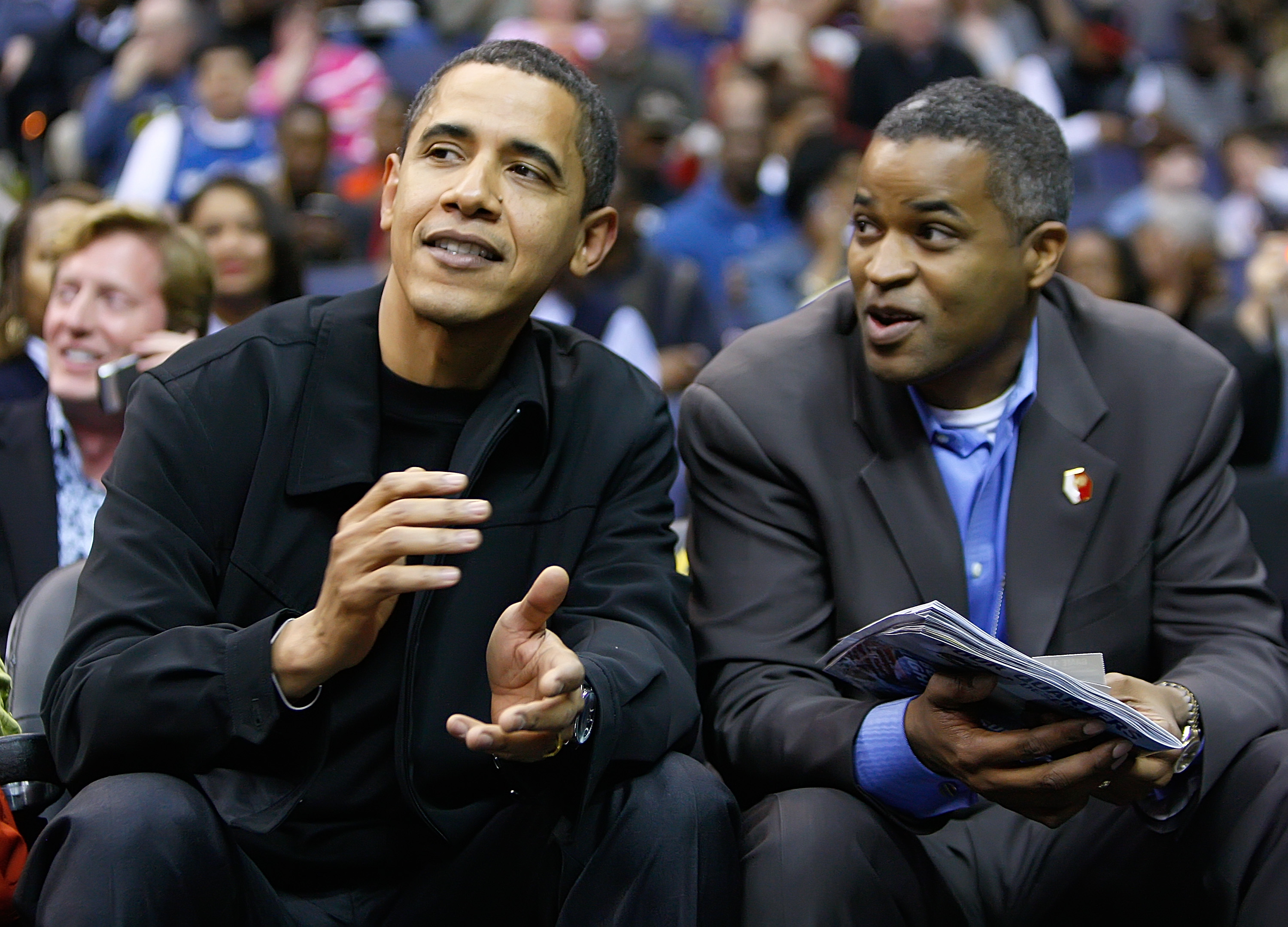 President Obama talks with friend Marty Nesbitt at a Bulls-Wizards game in 2009.