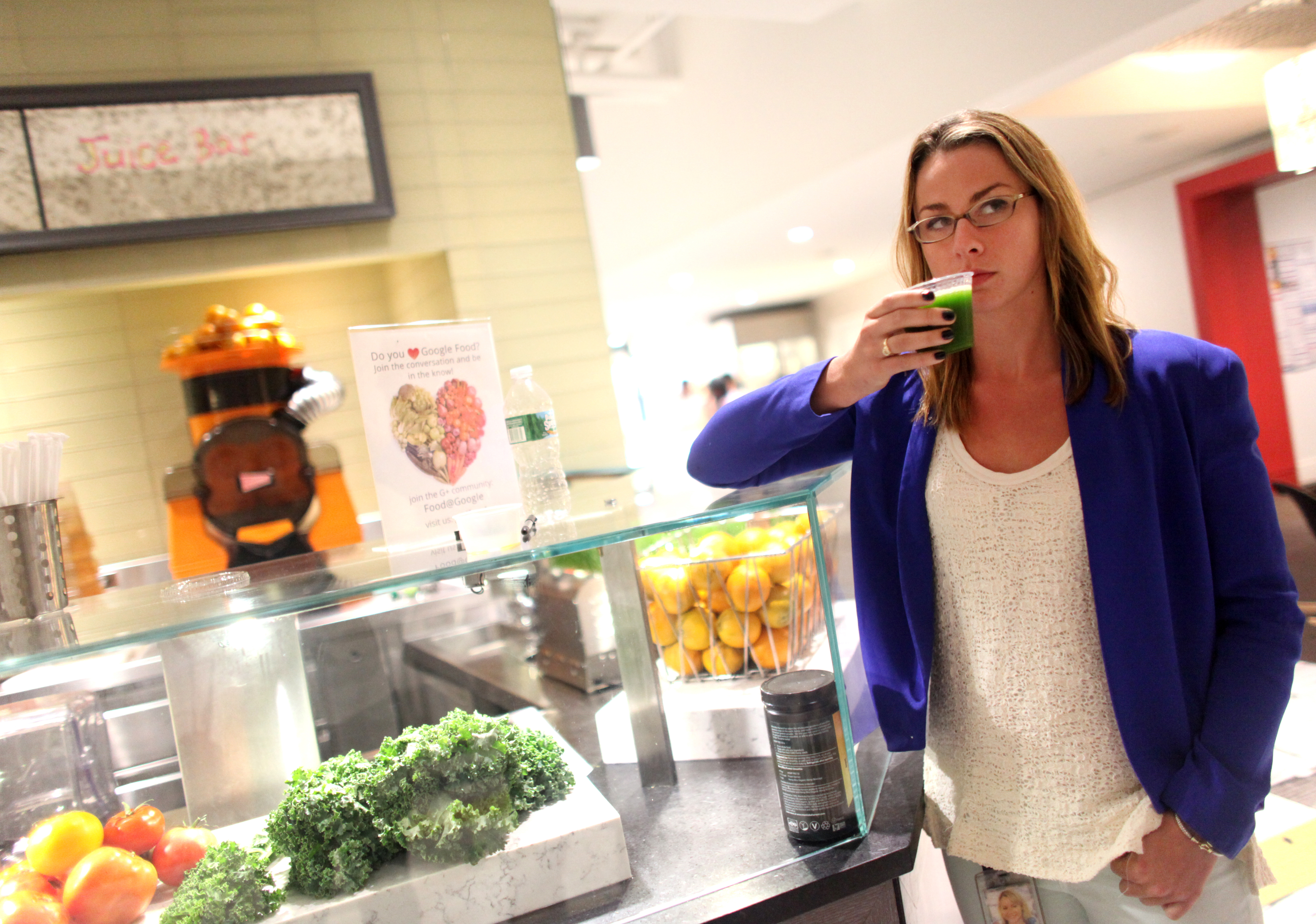 Michelle Sullivan from Zagat drinks juice in the 4th floor cafeteria at Google's headquarters in Manhattan, NY, on August 22, 2013.