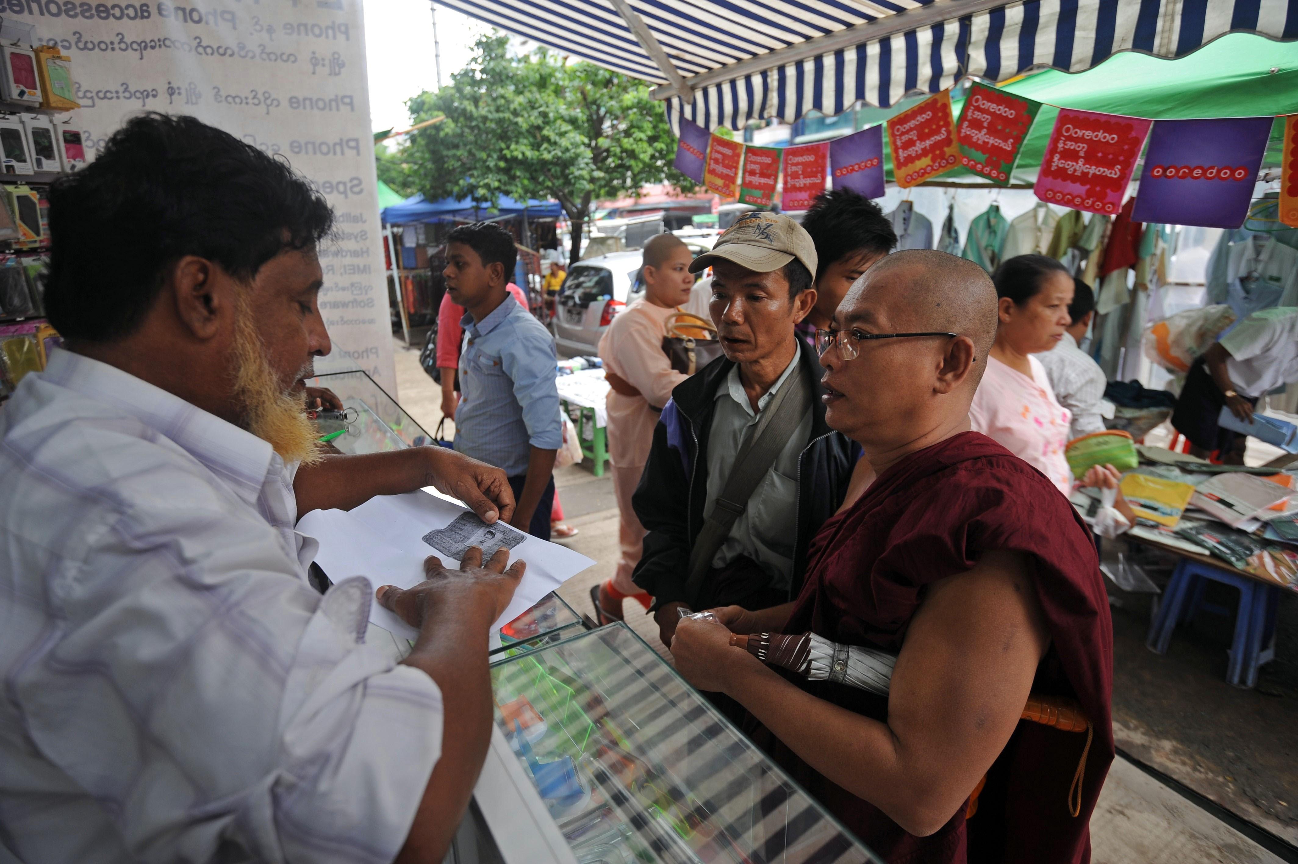 MYANMAR-QATAR-NORWAY-TELECOM-OOREDOO-TELENOR