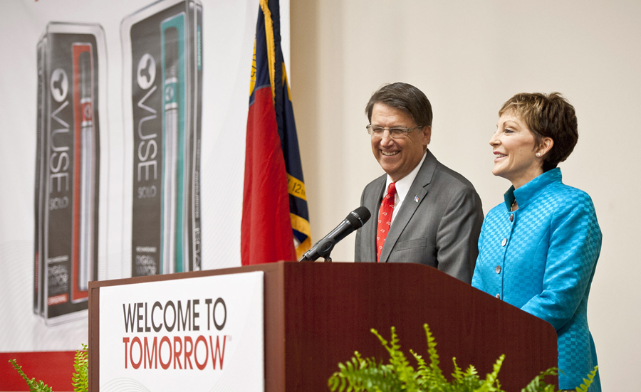 North Carolina Gov. Pat McCrory, left, and Reynolds American Inc. CEO Susan Cameron answer questions at a press conference, Friday, May 23, 2014, at Reynolds American's Tobaccoville, N.C., plant where the company announced 200 new jobs producing their Vuse brand electronic cigarette. (AP Photo/Winston-Salem Journal, Walt Unks).