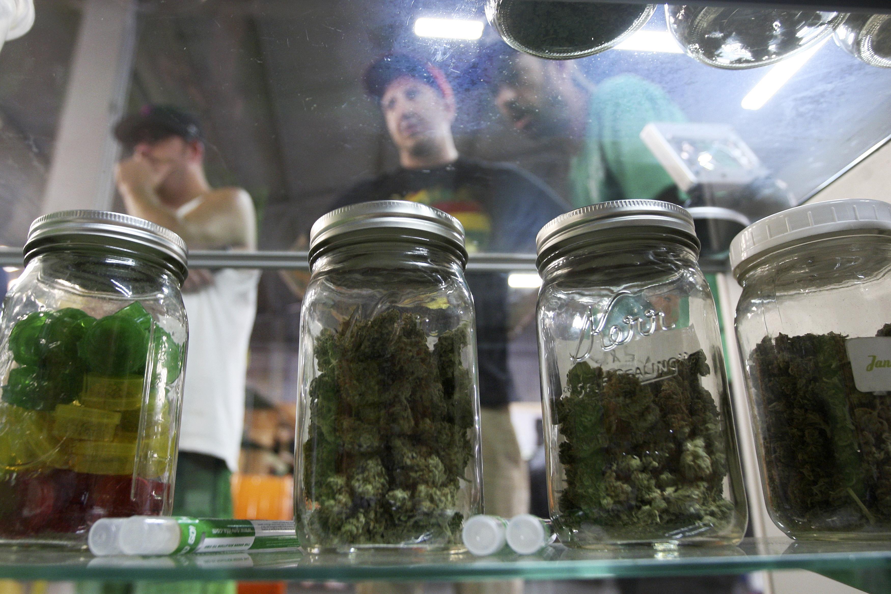 People look at jars of marijuana at the medical marijuana farmers market in Los Angeles
