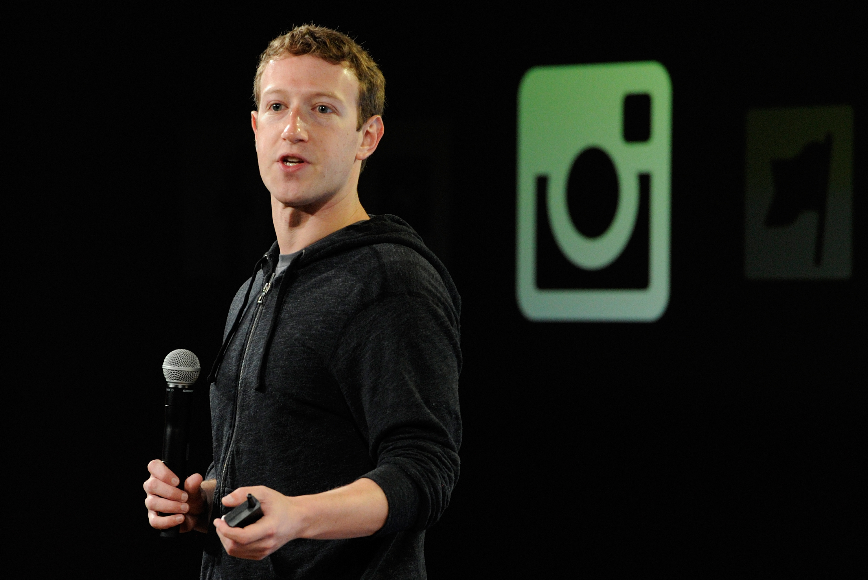 Facebook CEO Mark Zuckerberg in front of the Instagram logo in 2013. The social network bought Instagram, in which Thrive Capital invested, for $1 billion in 2012.