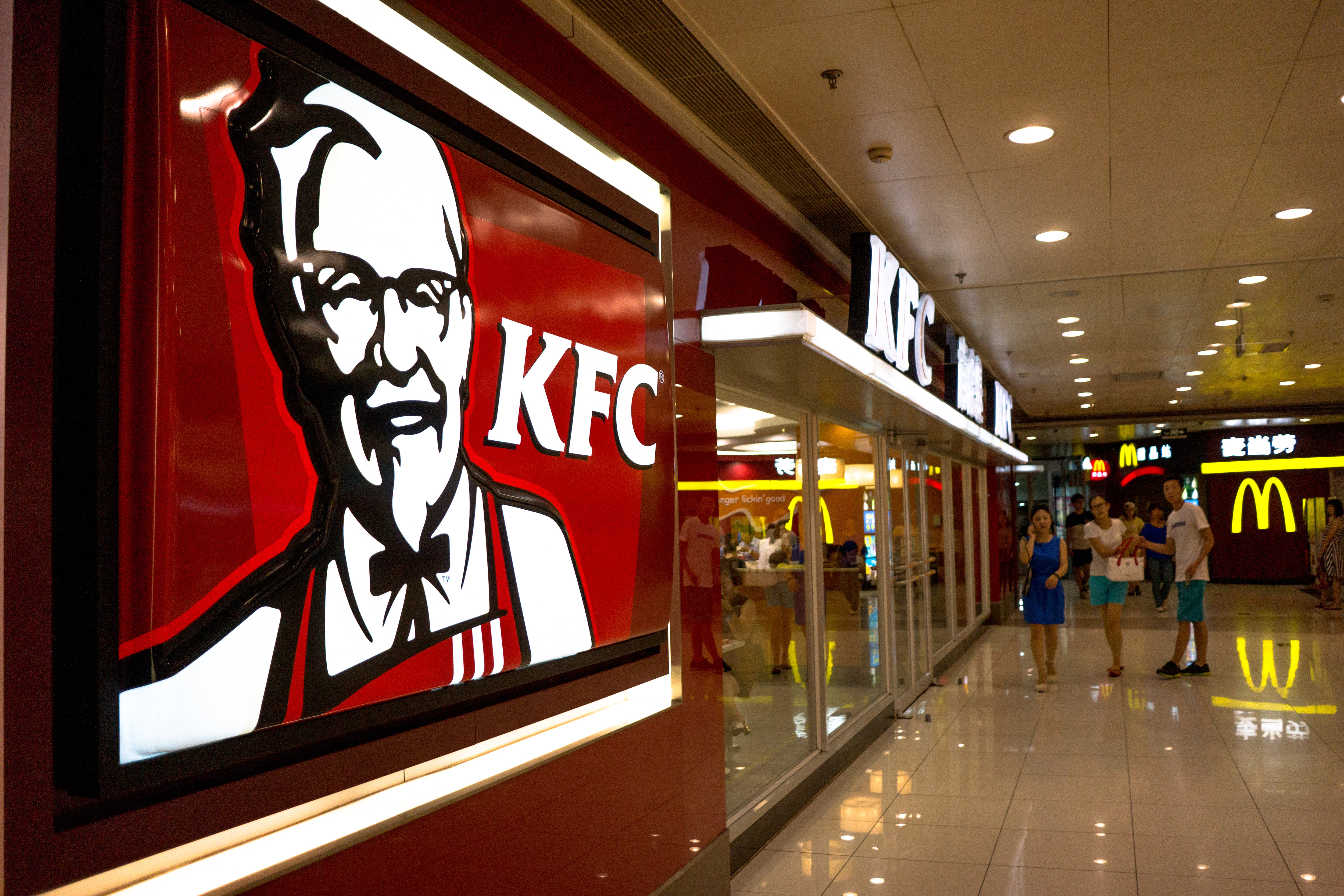 A KFC restaurant in a shopping mall.  KFC, McDonalds,