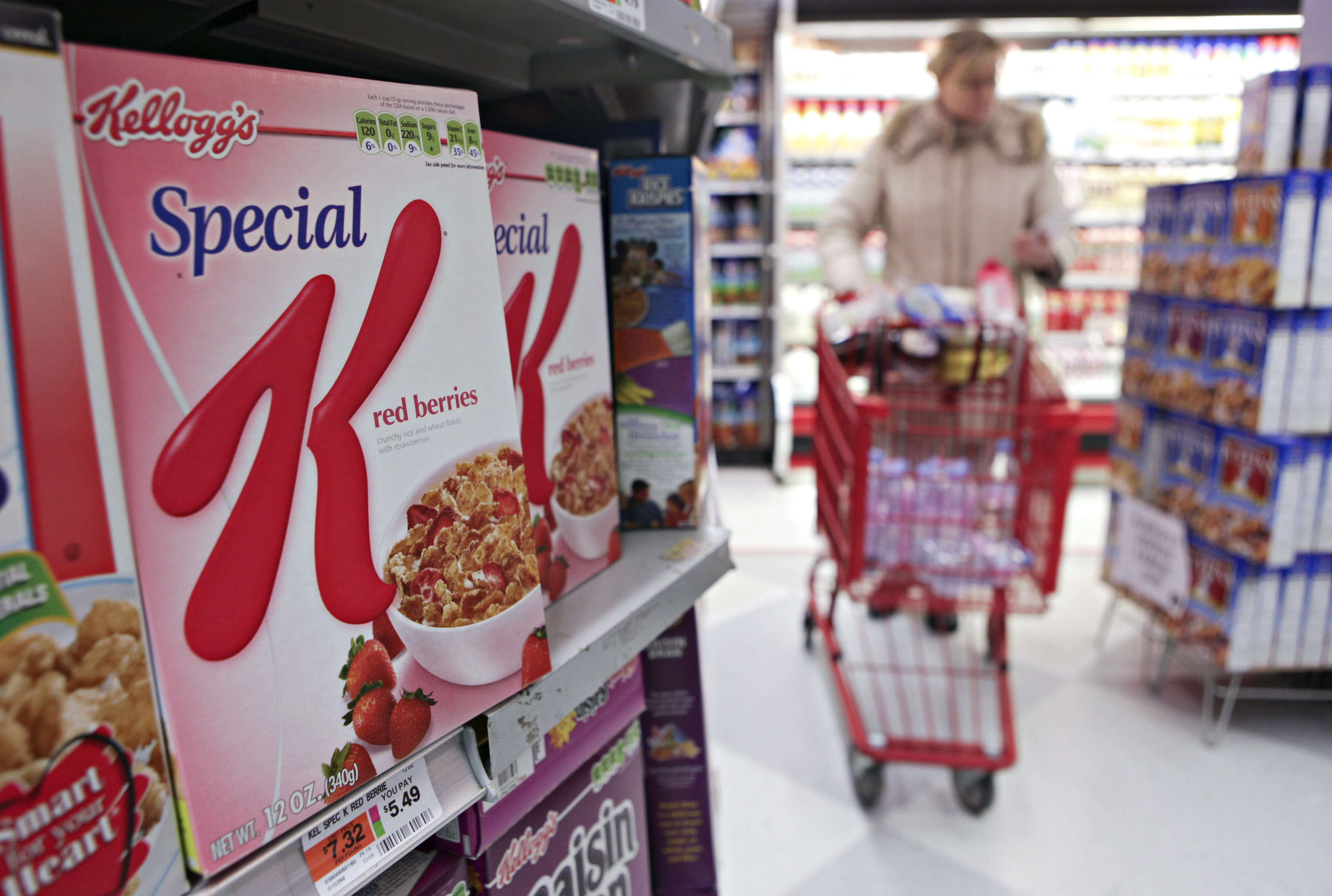 Kellogg's cereal products sit on display in a supermarket in