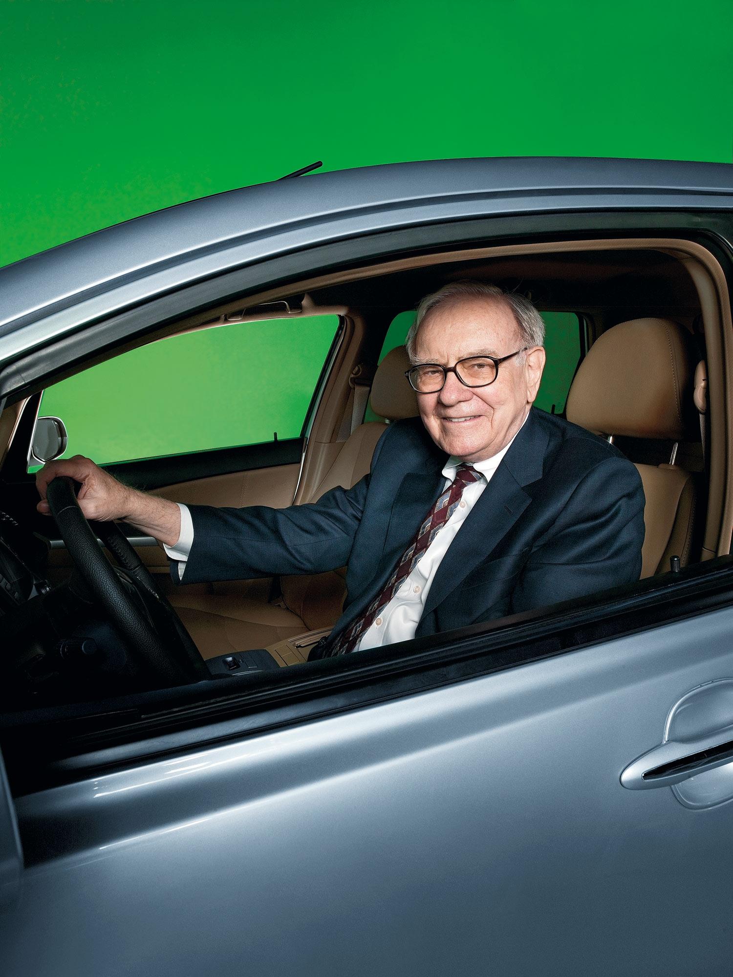 Warren Buffet sitting in a BYD car in Omaha Nebraka.