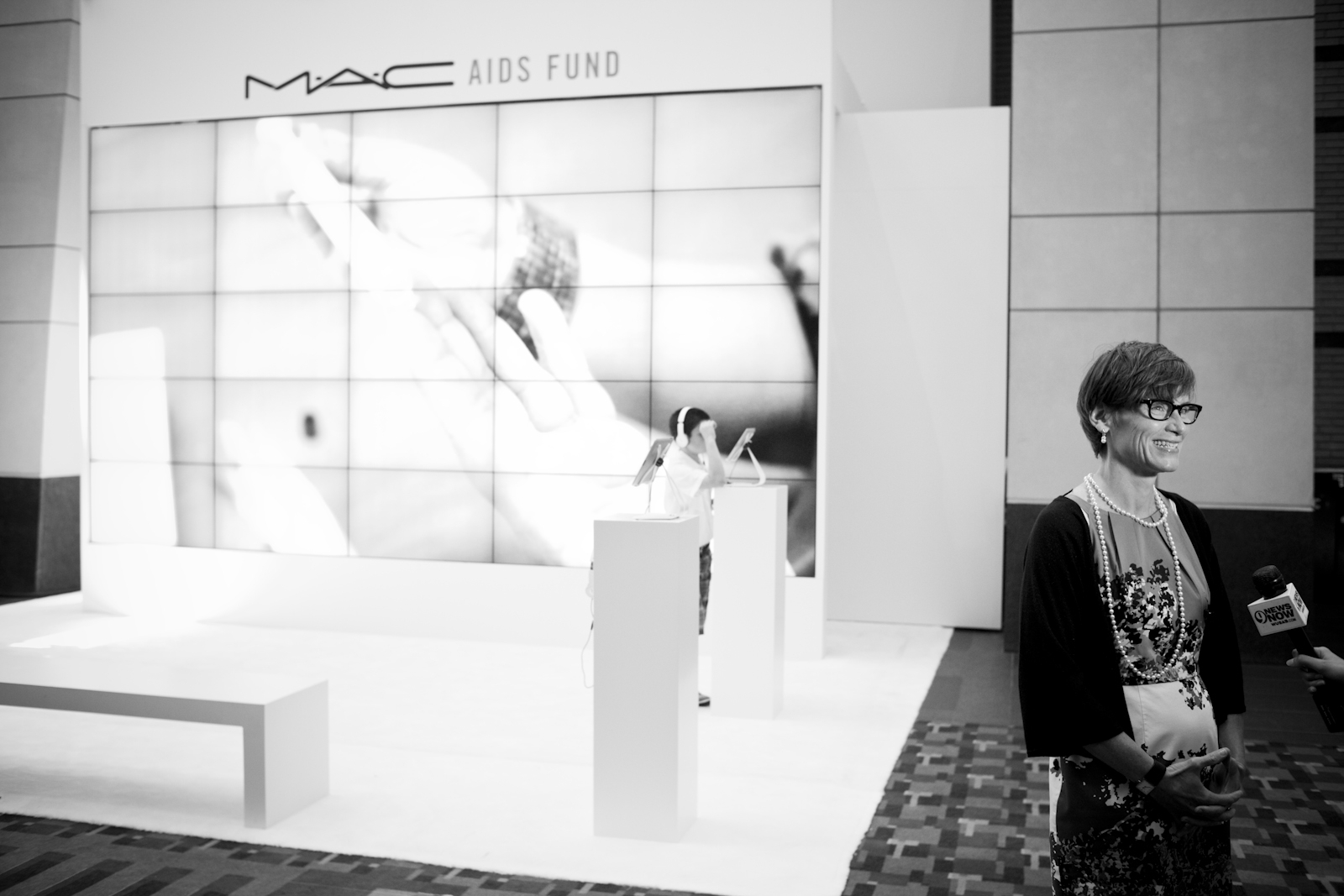Nancy Mahon, Estee Lauder's newly appointed SVP of global philanthropy and corporate citizenship, stands outside of a MAC Aids Fund display.