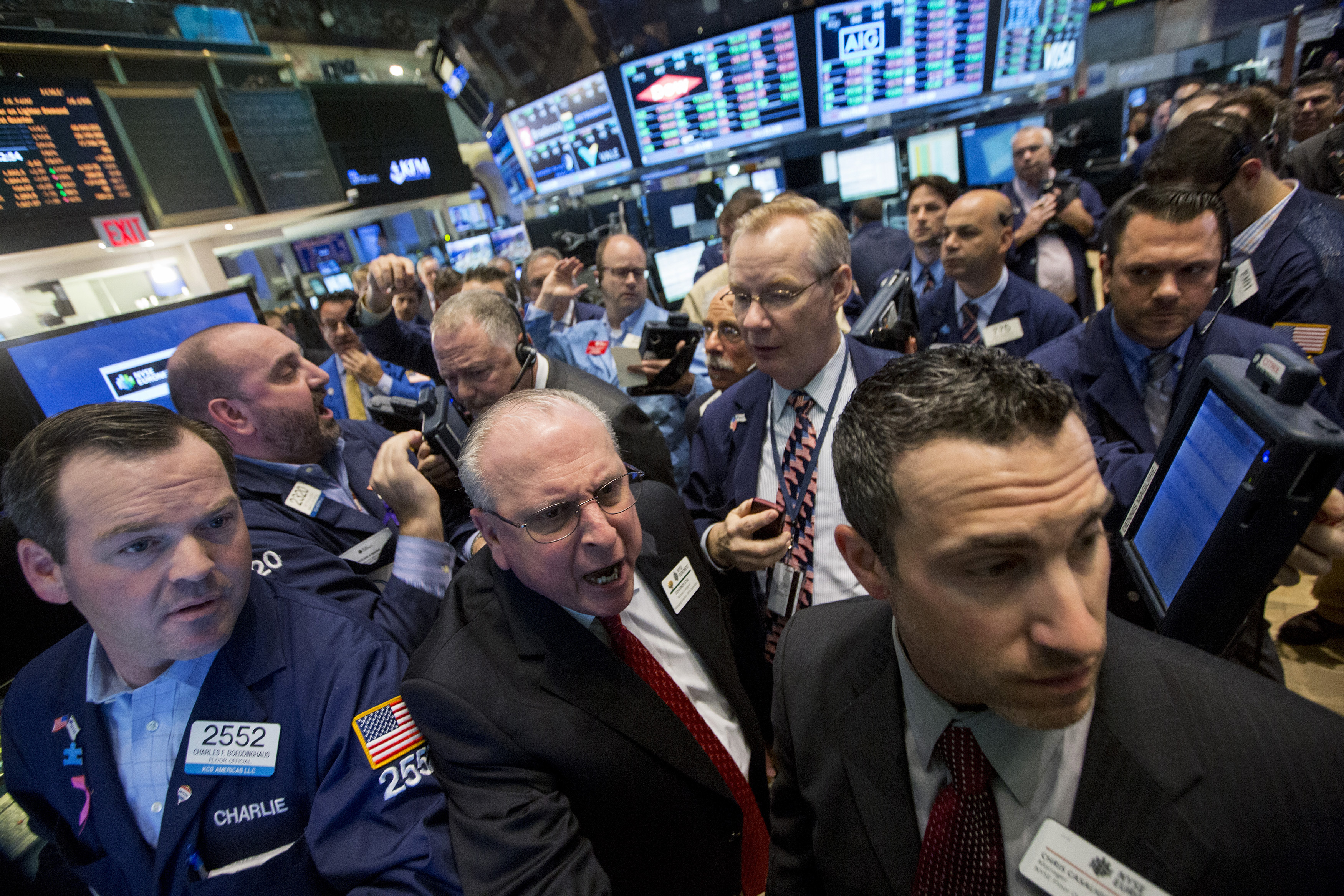 Traders work during the IPO of Parsley Energy Inc on the floor of the NYSE